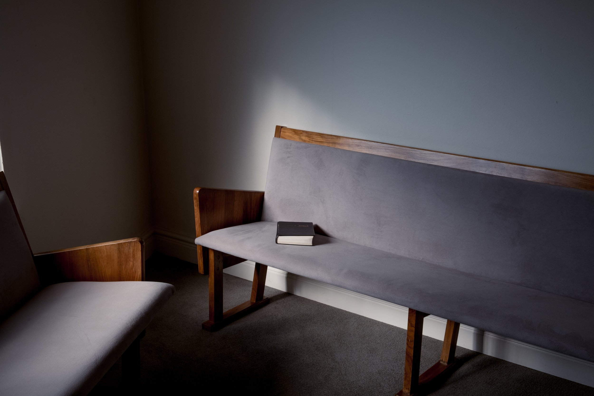 Church bench seats with Bible.jpg