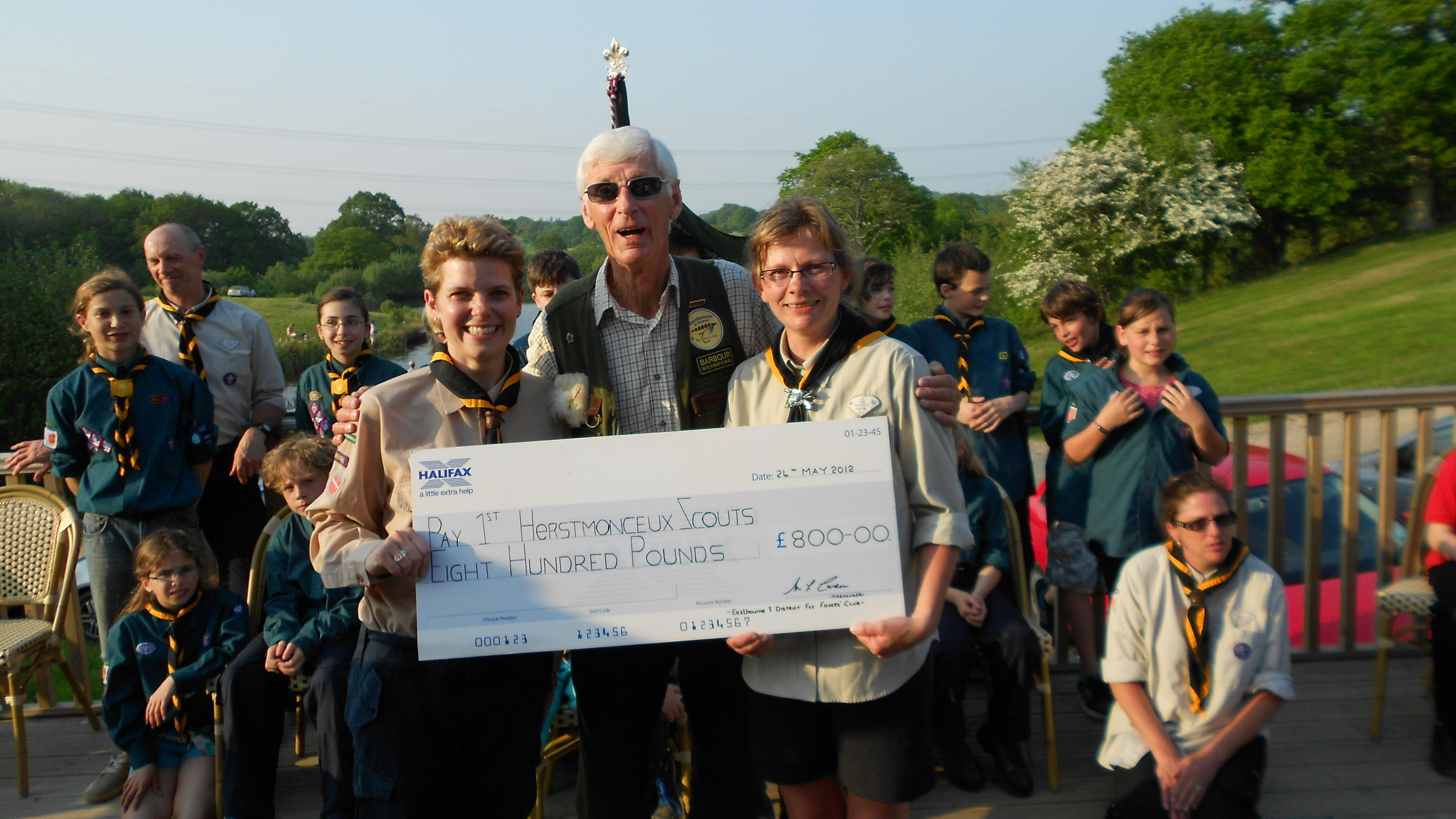 1st Herstmonceux Scout Group receiving £800 towards their new hut building fund from the Eastbourne and District Fly Fishing Club at Brick Farm Lakes
