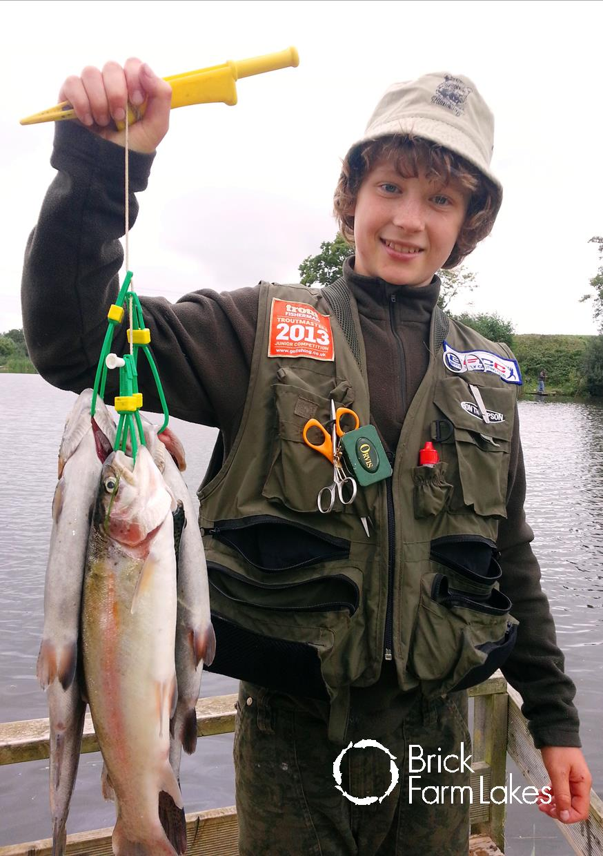 Roger Simeons, aged 12, with his bag of 4 rainbow trout caught on a glorious autumn day using a floating line with a midge tip and a self-tied Scruffy Montana