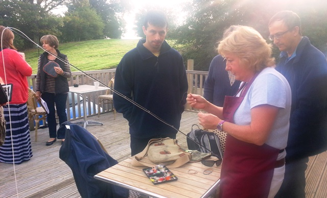 Caroline Cutmore helping some novice anglers prepare to fish