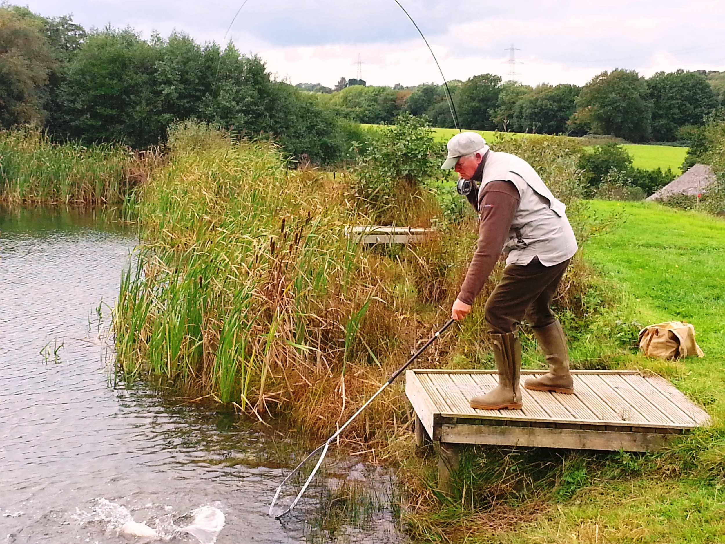 Peter James fishing in Well Lake on a stunning autumn day