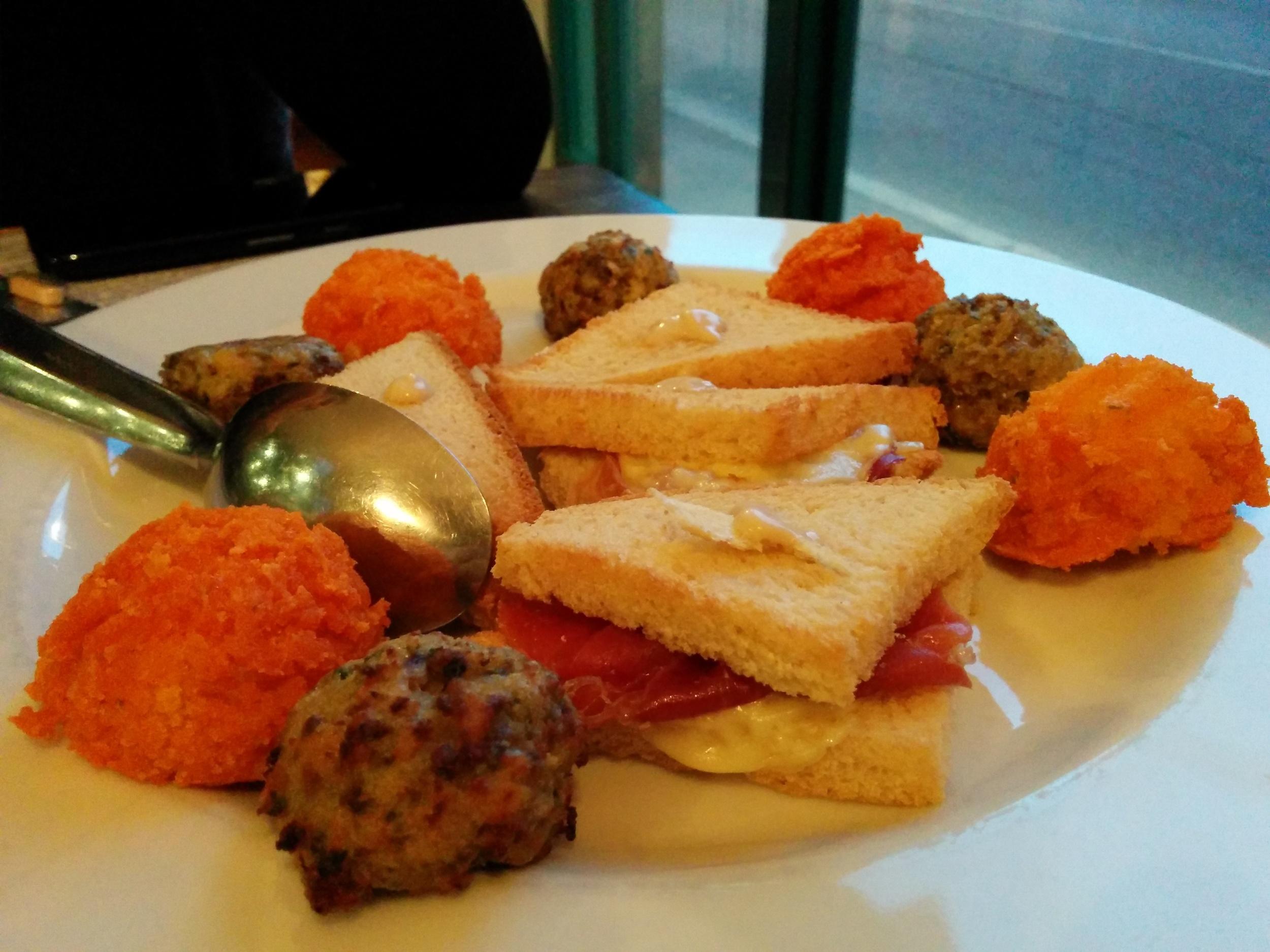 meatballs, polenta balls, crudo and fontina cheese toast
