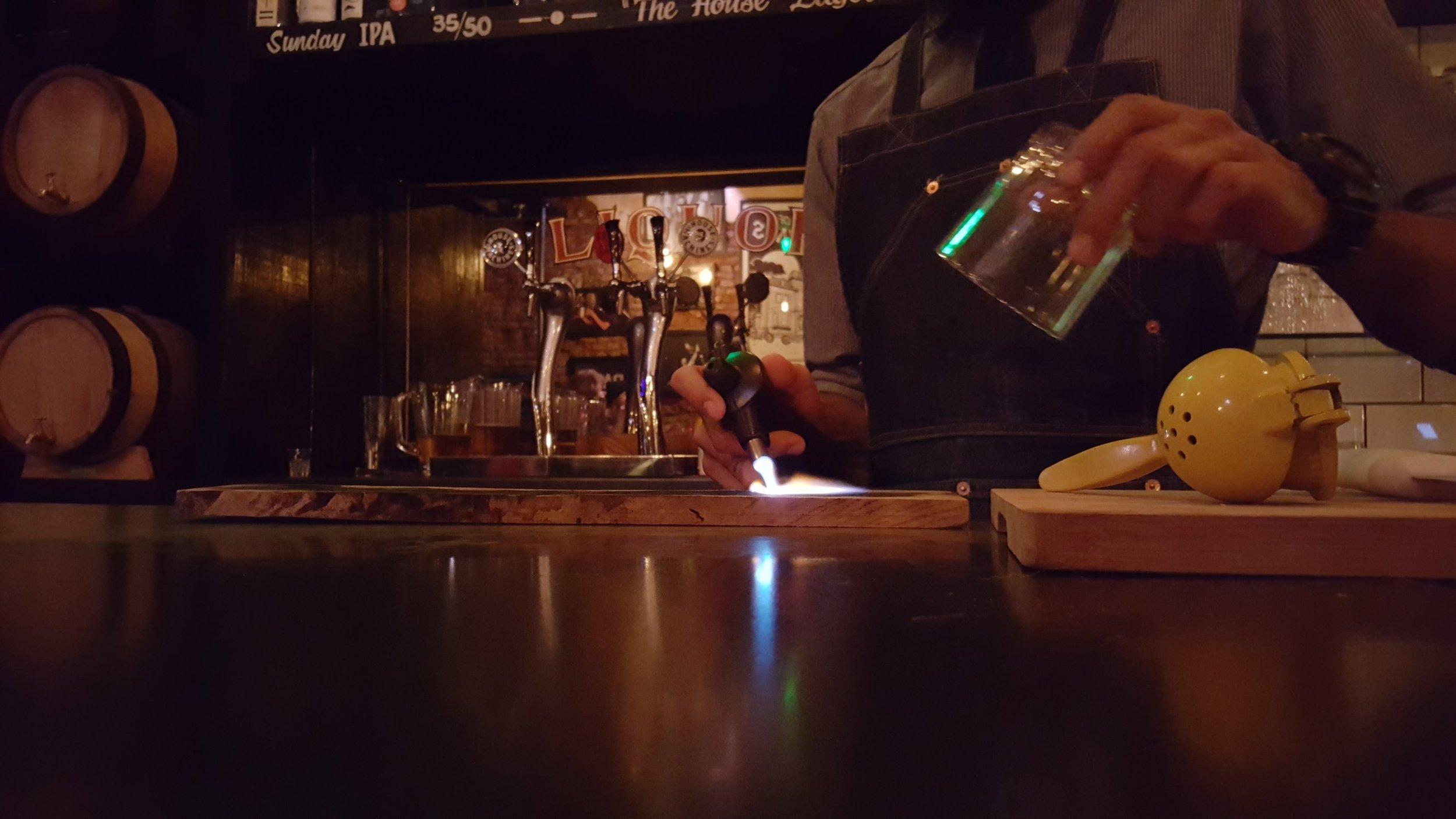 Marshall prepares a smokey Old Fashioned
