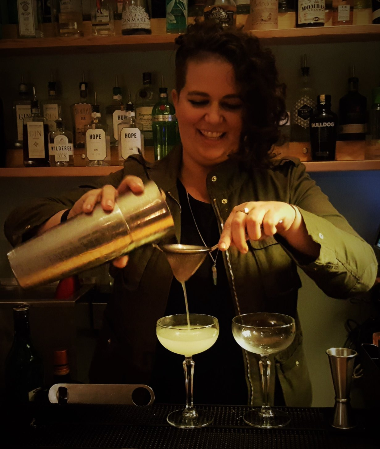 Caitlin pours two delicious Corpse Reviver no. 2 cocktails