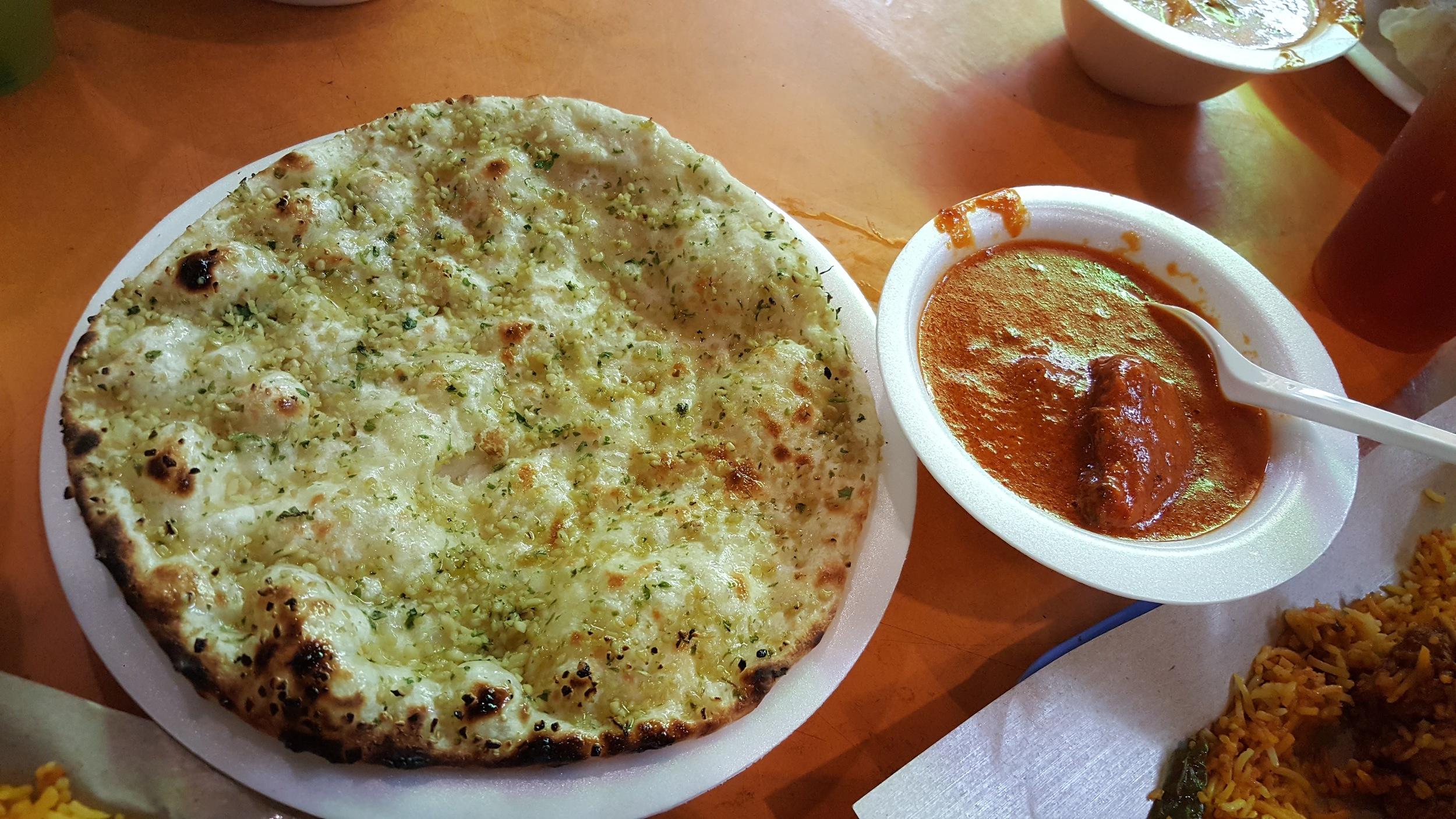 Garlic naan and butter chicken at Al-Madina food corner (Tekka center, Little India)
