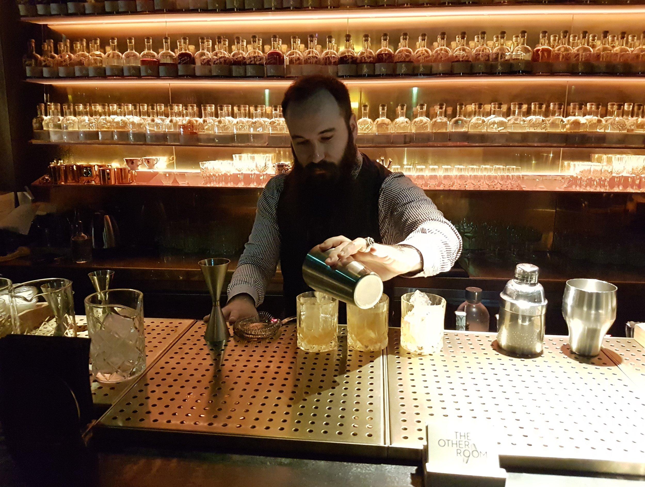ben pouring kilchoman cocktail.jpg