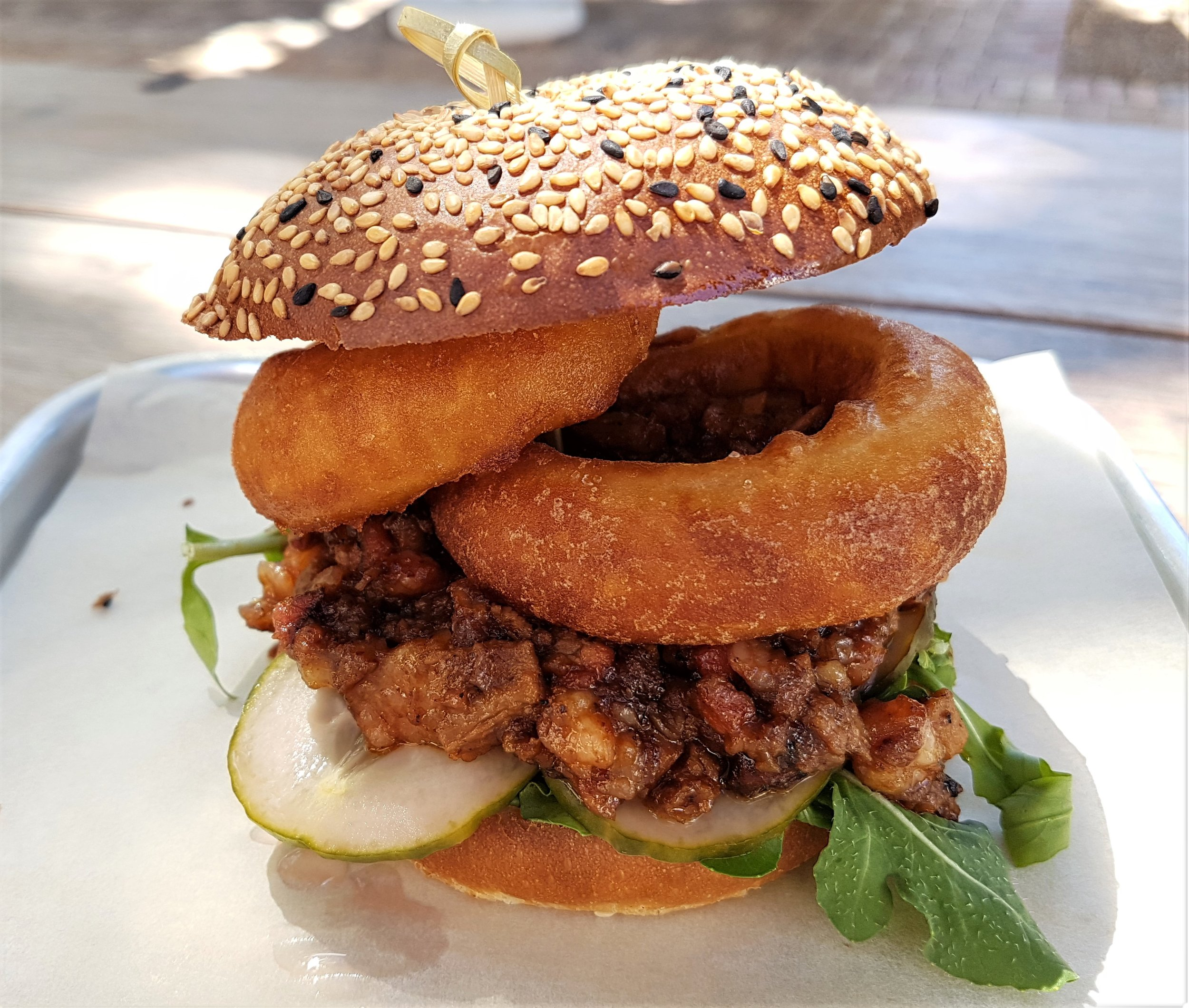 beef brisket with onion rings, watercress, butter pickles