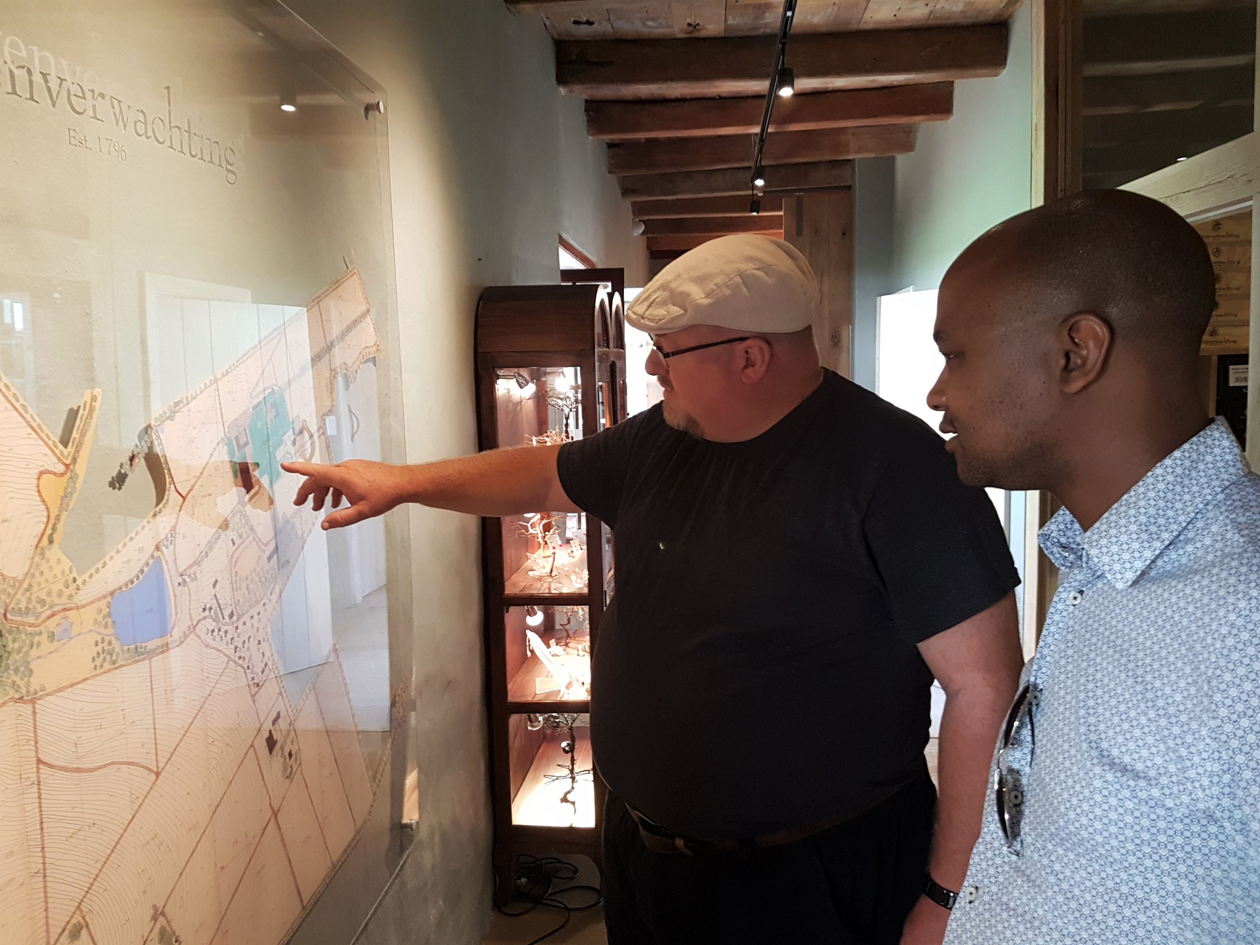 Gavin showing Lebo the layout of the huge wine farm