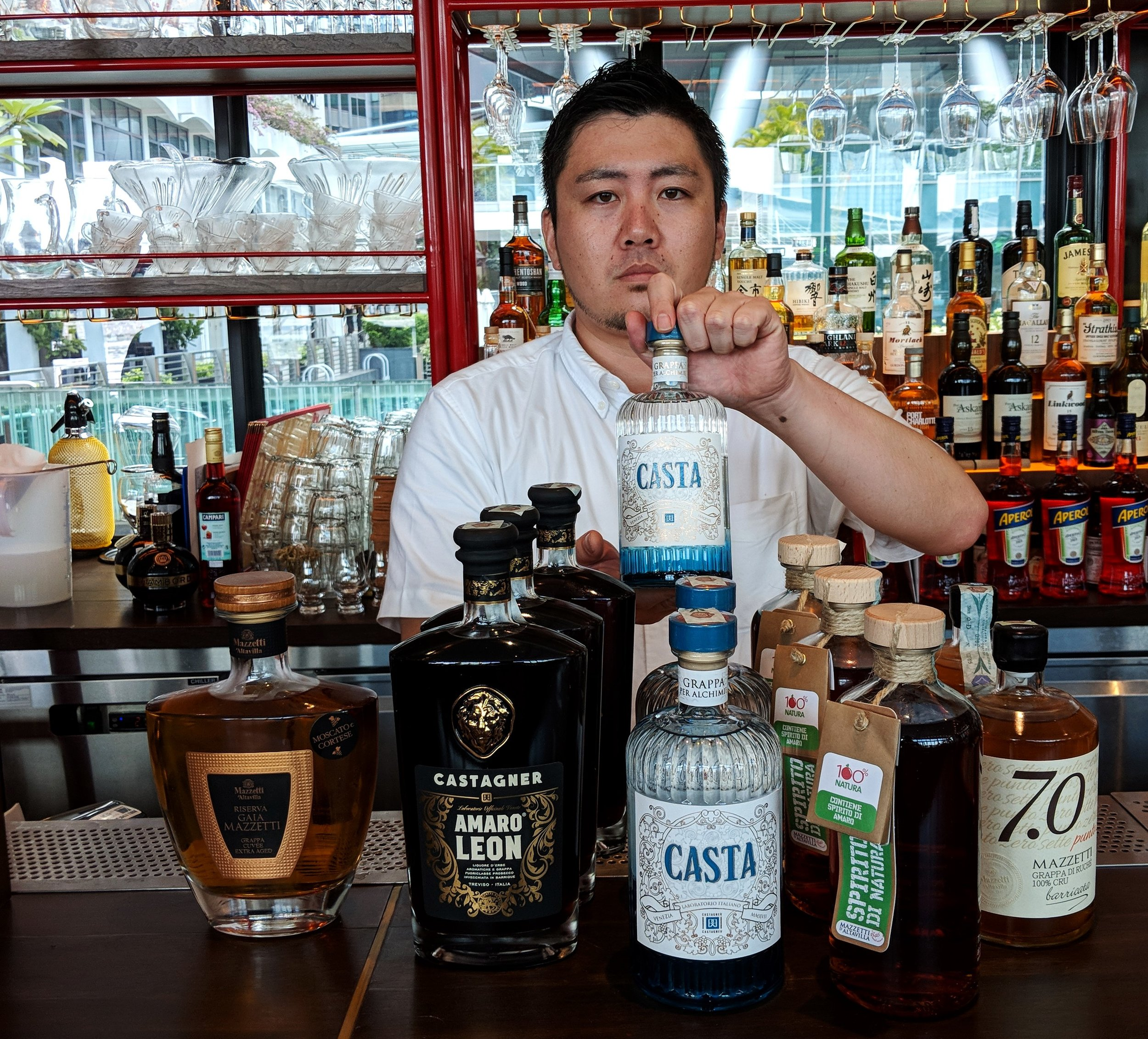 Aki of Caffe Fernet showing of Castagner and Mazzetti grappe and amari