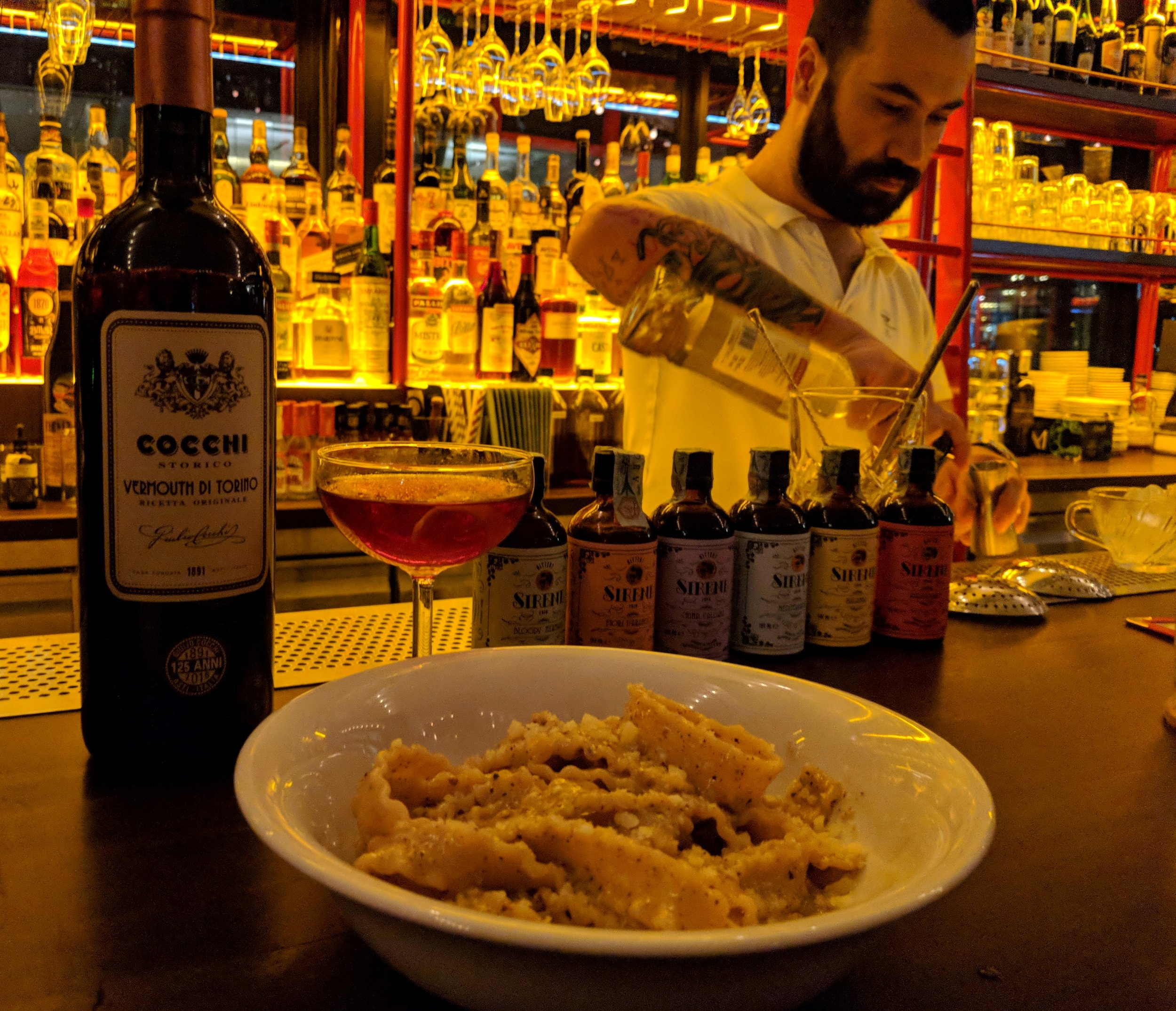 Diego uses Cocchi sweet vermouth of Torino, Liquore delle Sirene bitters and Luxardo gin in making a cocktail at Caffe Fernet