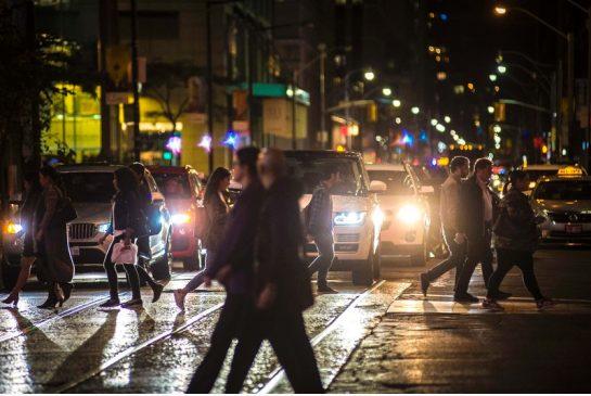 Pedestrians cross a street at night in downtown Toronto on Oct. 5. (Photo EDUARDO LIMA / METRO)