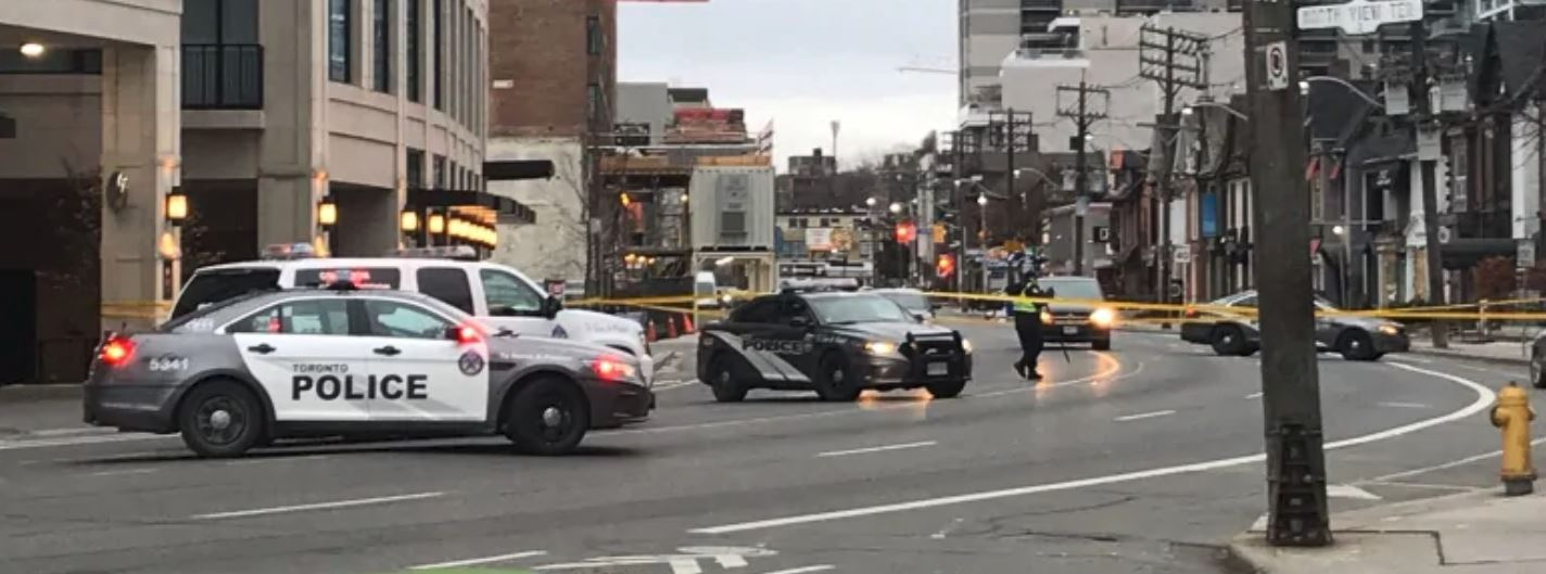 Toronto police have closed Davenport Road from Avenue Road to Belmont Street after an early morning crash injured three people. One, a woman believed to be in her 30s, is in life-threatening condition. (Andrea Janus/CBC)