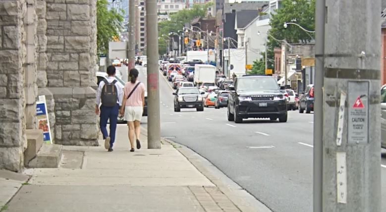 Along Avenue Road, the width of the sidewalk widens and narrows over the course of the street, with some spots tightened by lampposts and buildings jutting out. (Richard Agecoutay/CBC News)