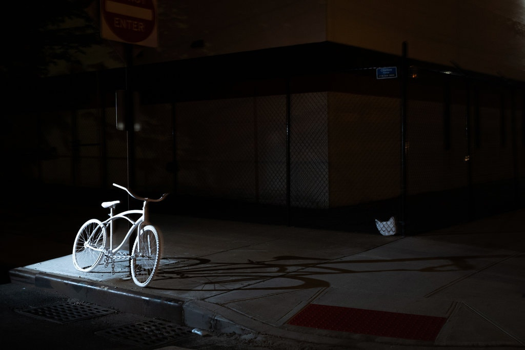 """A """"ghost bike"""" memorial for a cyclist who was killed near the intersection of East 28th Street and Third Avenue in Manhattan.CreditCreditIvan Armando Flores for The New York Times"""