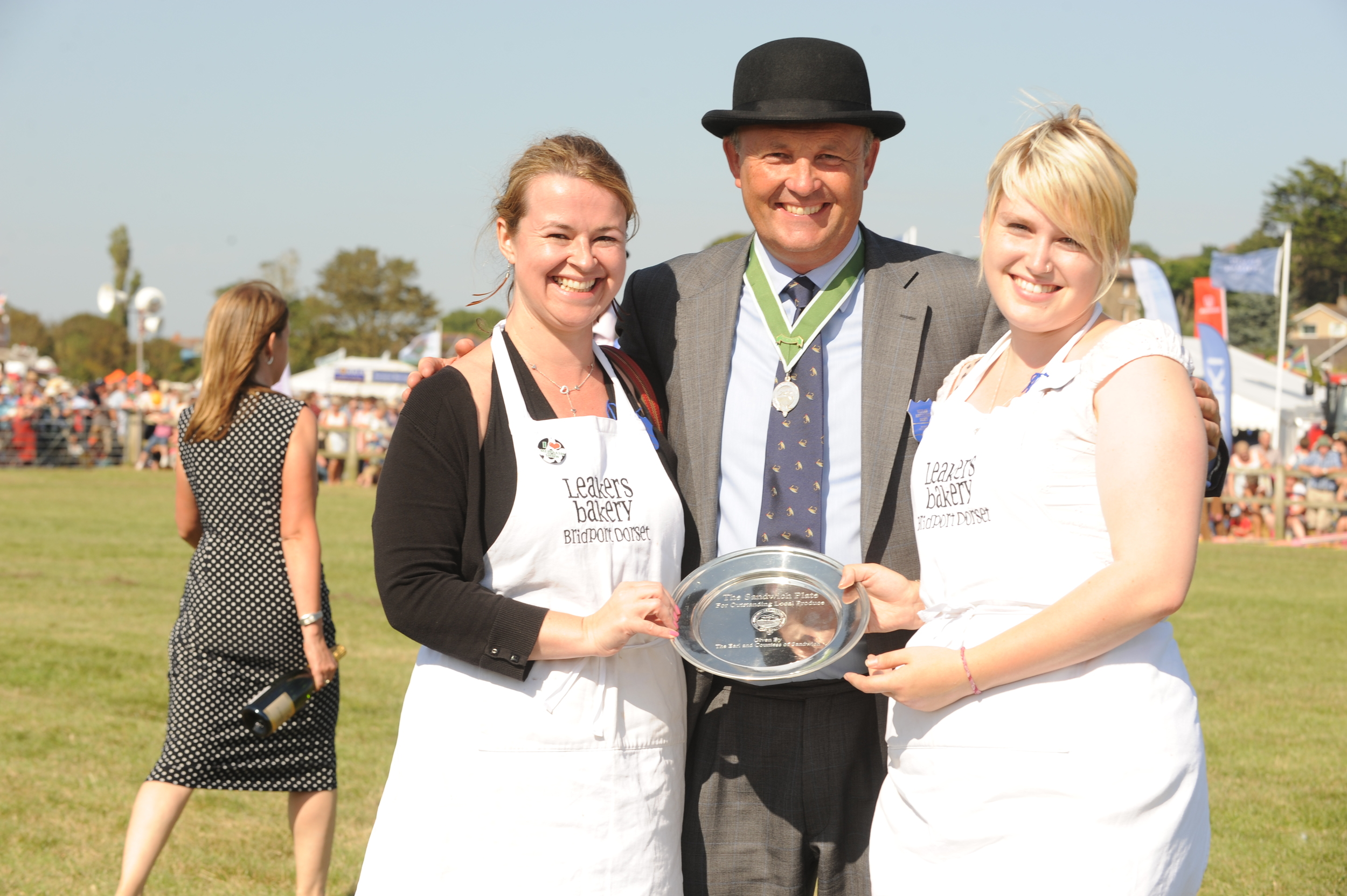 Leakers' Clare and Jemima with Cleeves Palmer receiving the Sandwich Plate for Outstanding Local Produce at this year's Melplash Show.