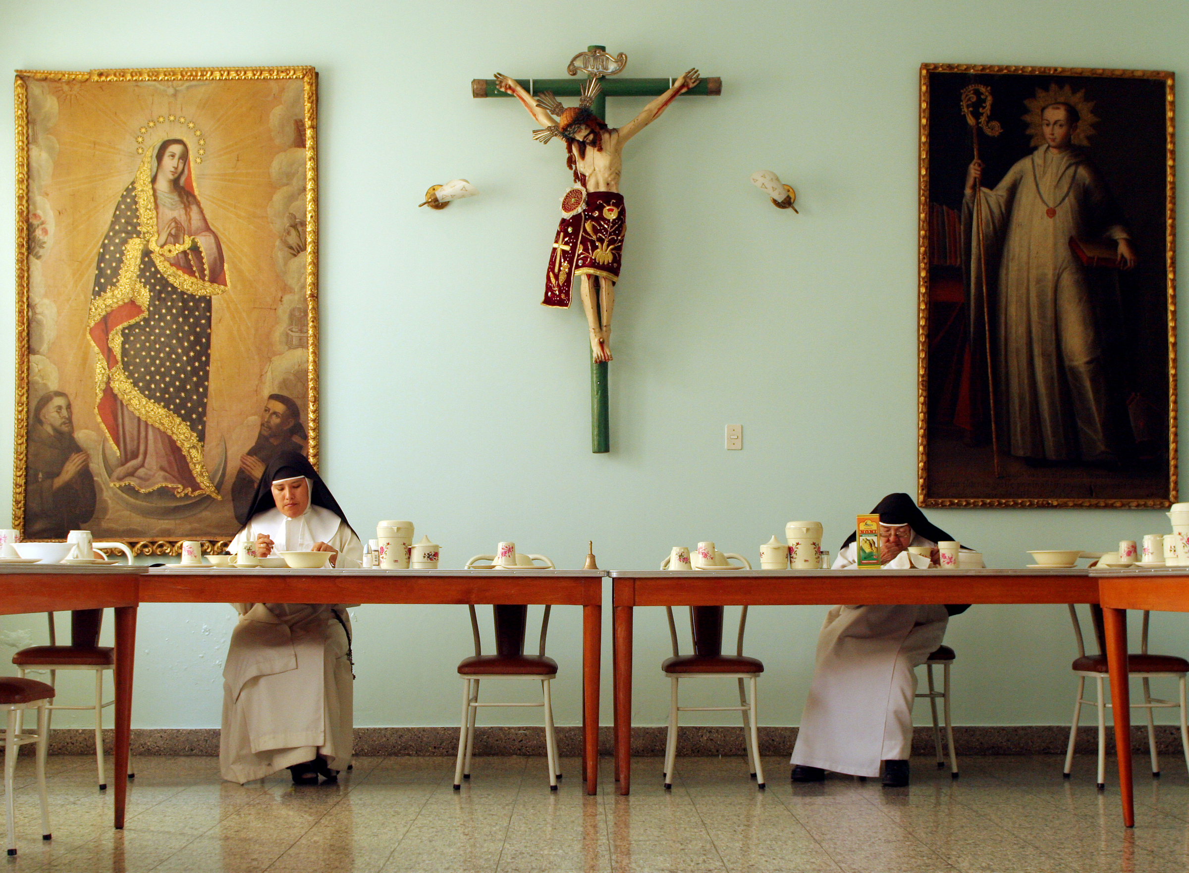 Sister Consuelo, right, eats breakfast every day at 8:15 a.m., after waking up at 5 a.m. and attending the morning prayer and daily Mass. As a cloistered nun, each hour of her day is devoted to Christ; the nuns meditate and think about God even during their recreation time.
