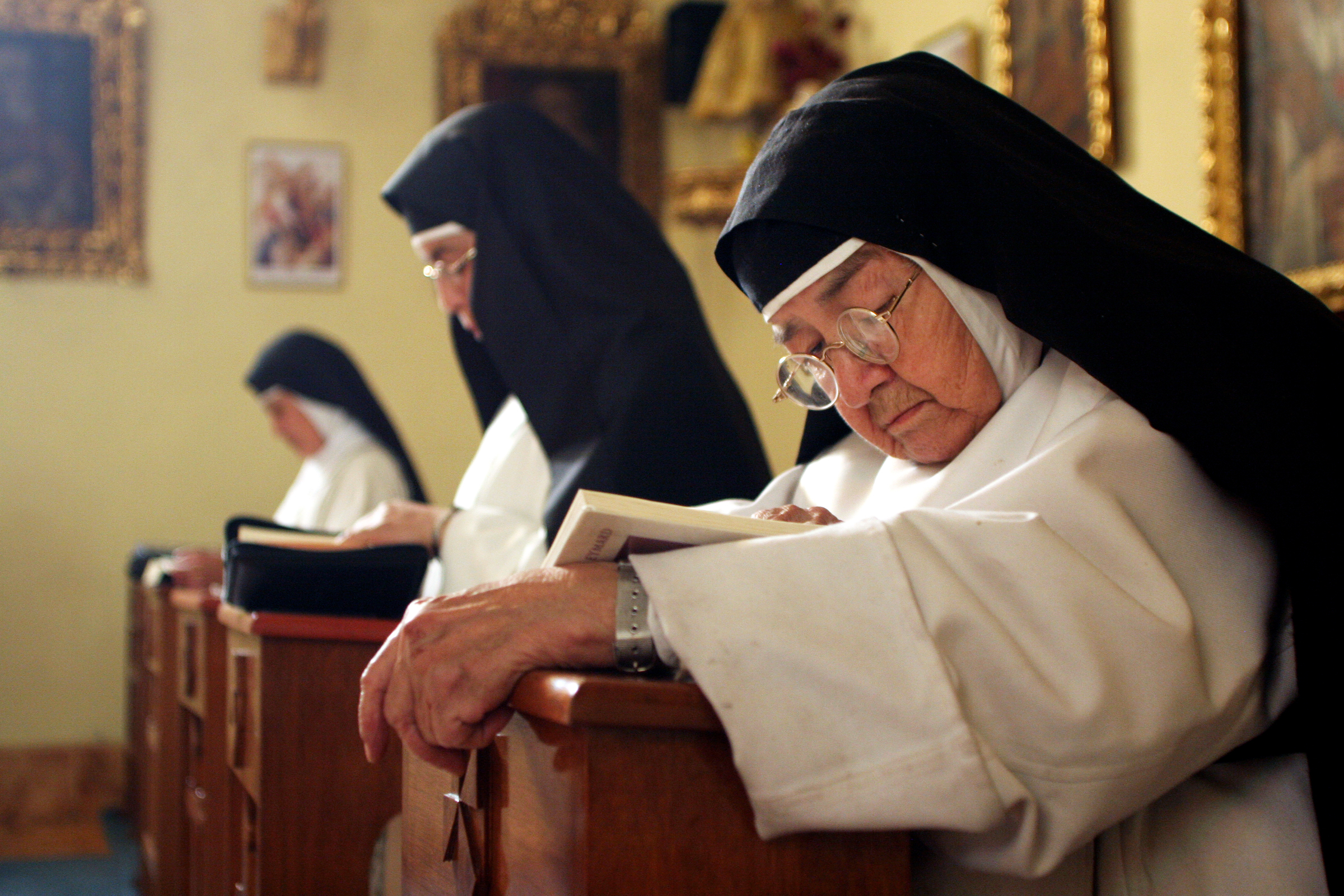 Sister Consuelo de Jesus concentrates on her Bible study, or Lexio Divino, during silent prayer in Santa Catalina Monastery's chapel. The nuns gather five times a day for prayer, the methods of which vary from singing, to chanting, to reciting the rosary.