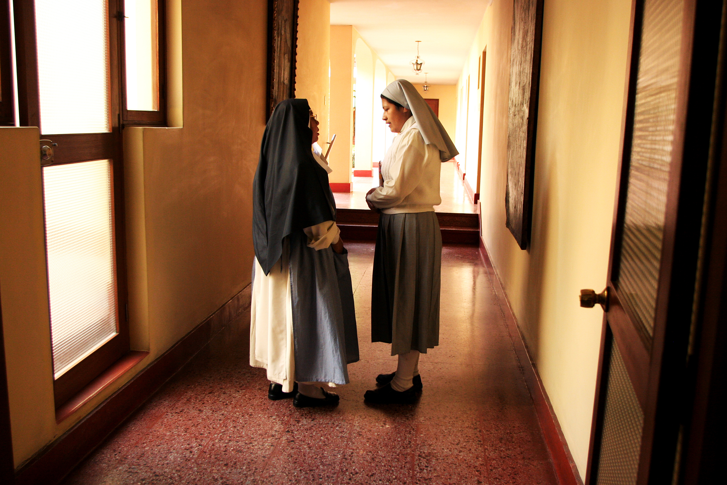 Sister Heidi stops to ask Mother Superior Isabel a question. There are several stages to becoming a Dominican nun; after initial inquiry, where the candidate communicates with one of the nuns from her home in order to decide whether becoming a nun is the right vocation for her, she moves onto Aspirancy. Heidi is currently in this second stage; she has lived in the monastery for 3 months. The purpose of this stage is to ensure that she likes her new life and will continue to be committed to it.