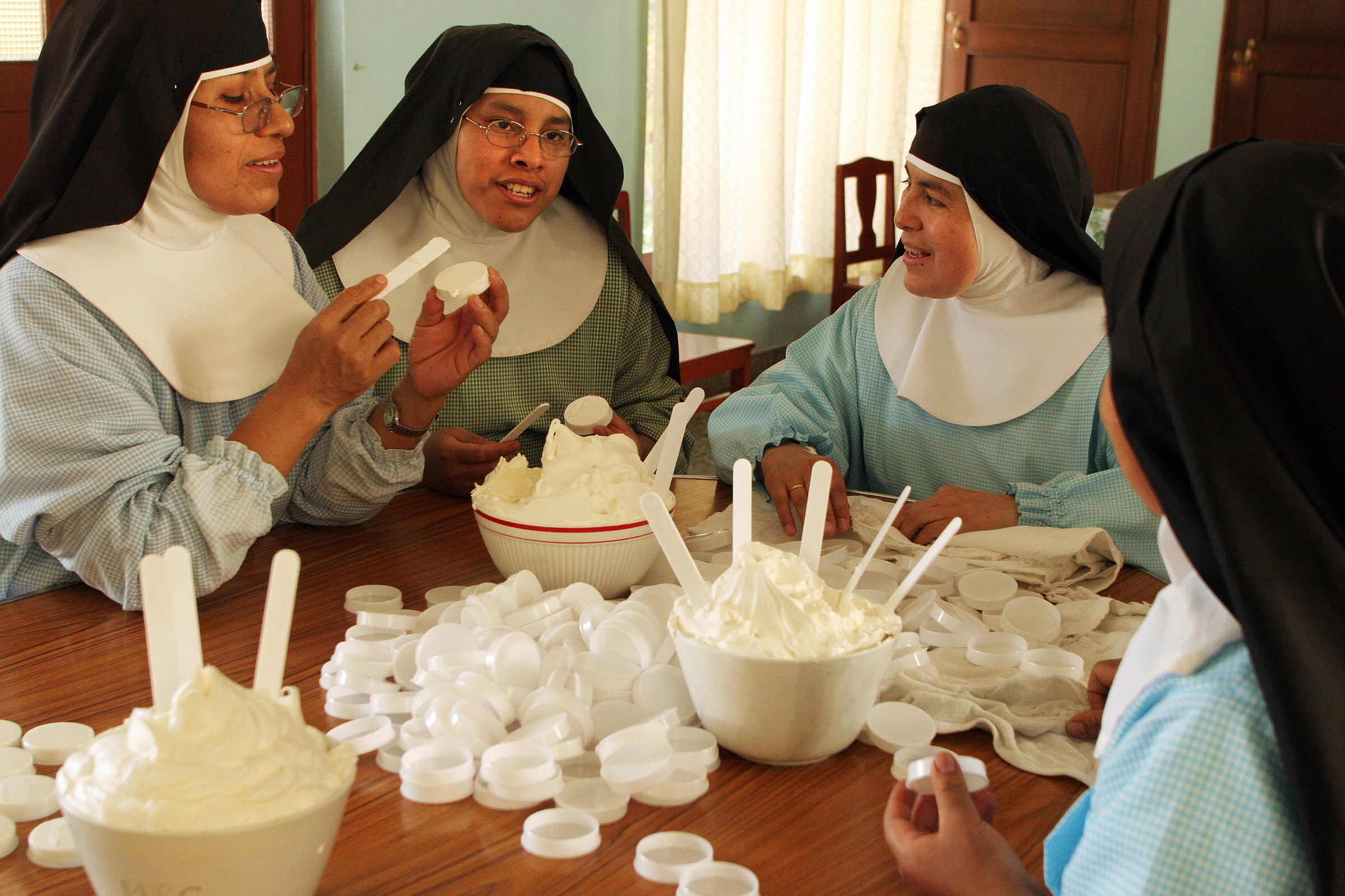 Nuns make rose cream , which will later be sold in the tourist section of the monastery. The profits from such handicrafts help support the nuns.