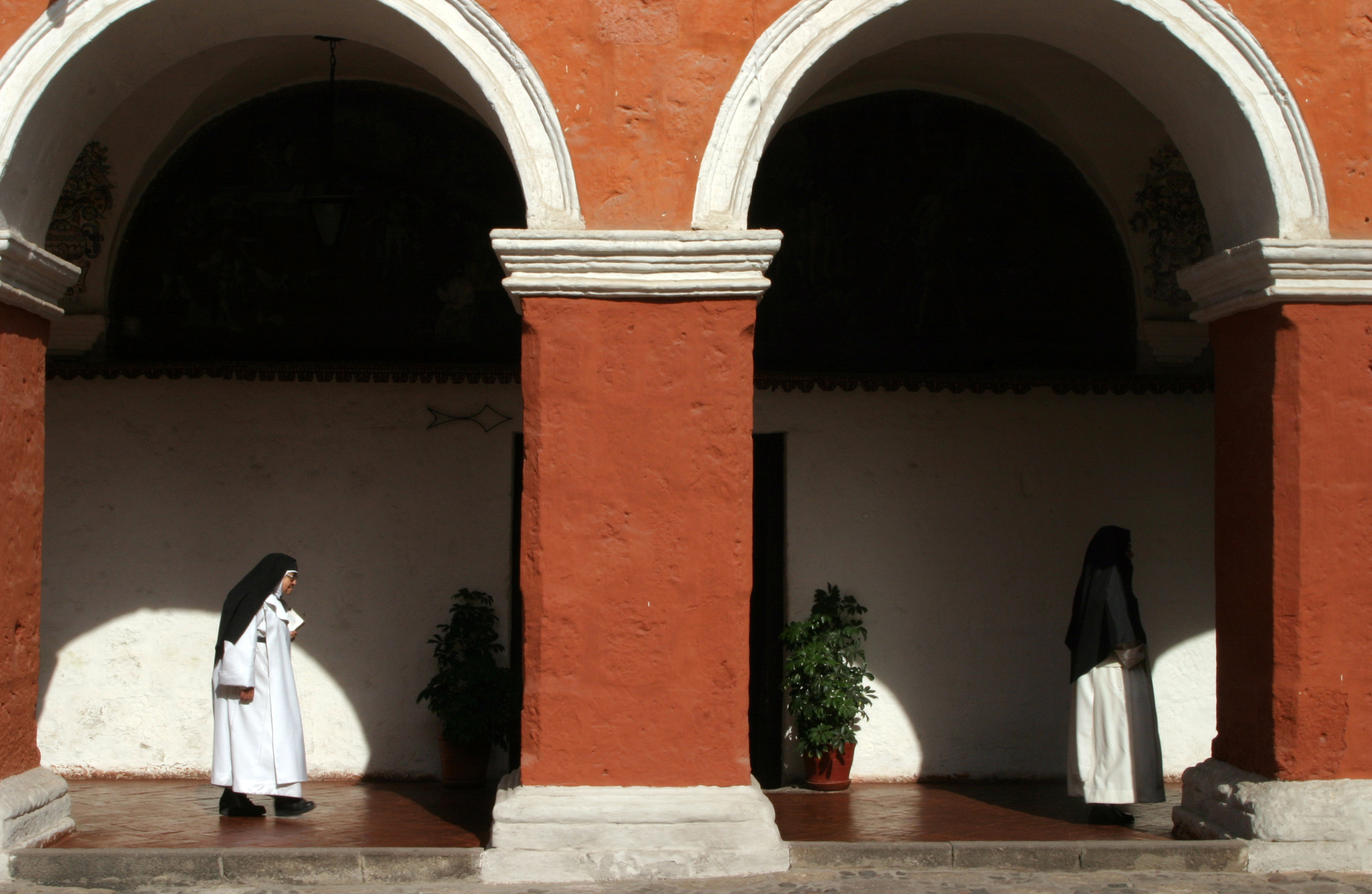 Sister Consuelo de Jesus walks back to the private part of the monastery after morning Mass.