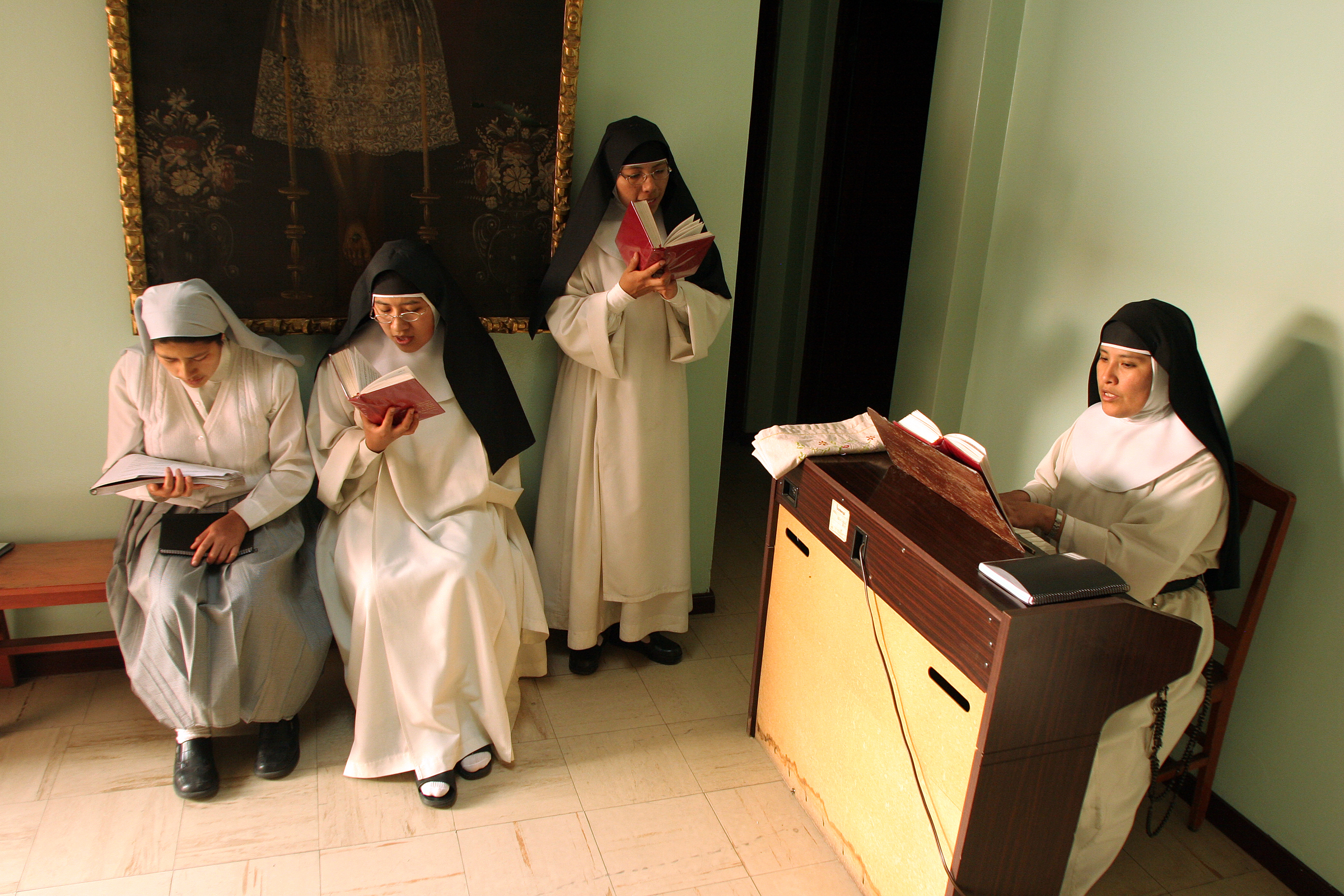 The sisters conduct choir practice.