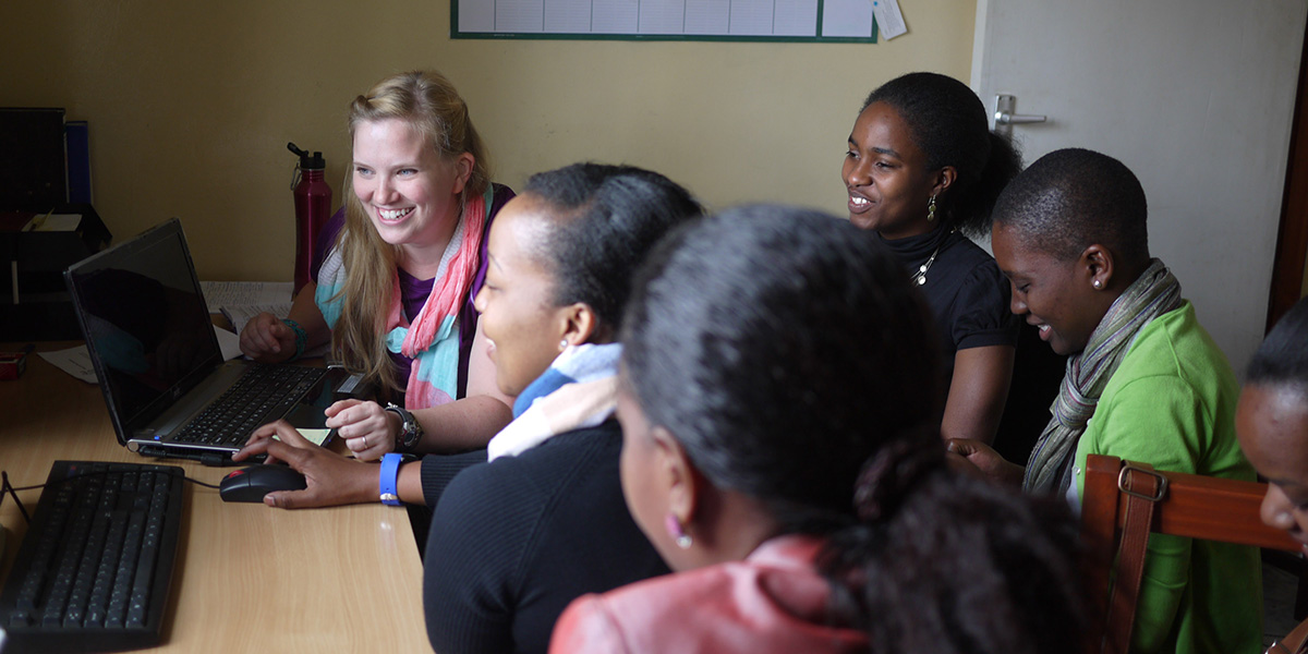 Teaching mentors from AfricAid's Kisa Project how to improve their photography and video in Arusha, Tanzania. (Photo by Christen Brandt)