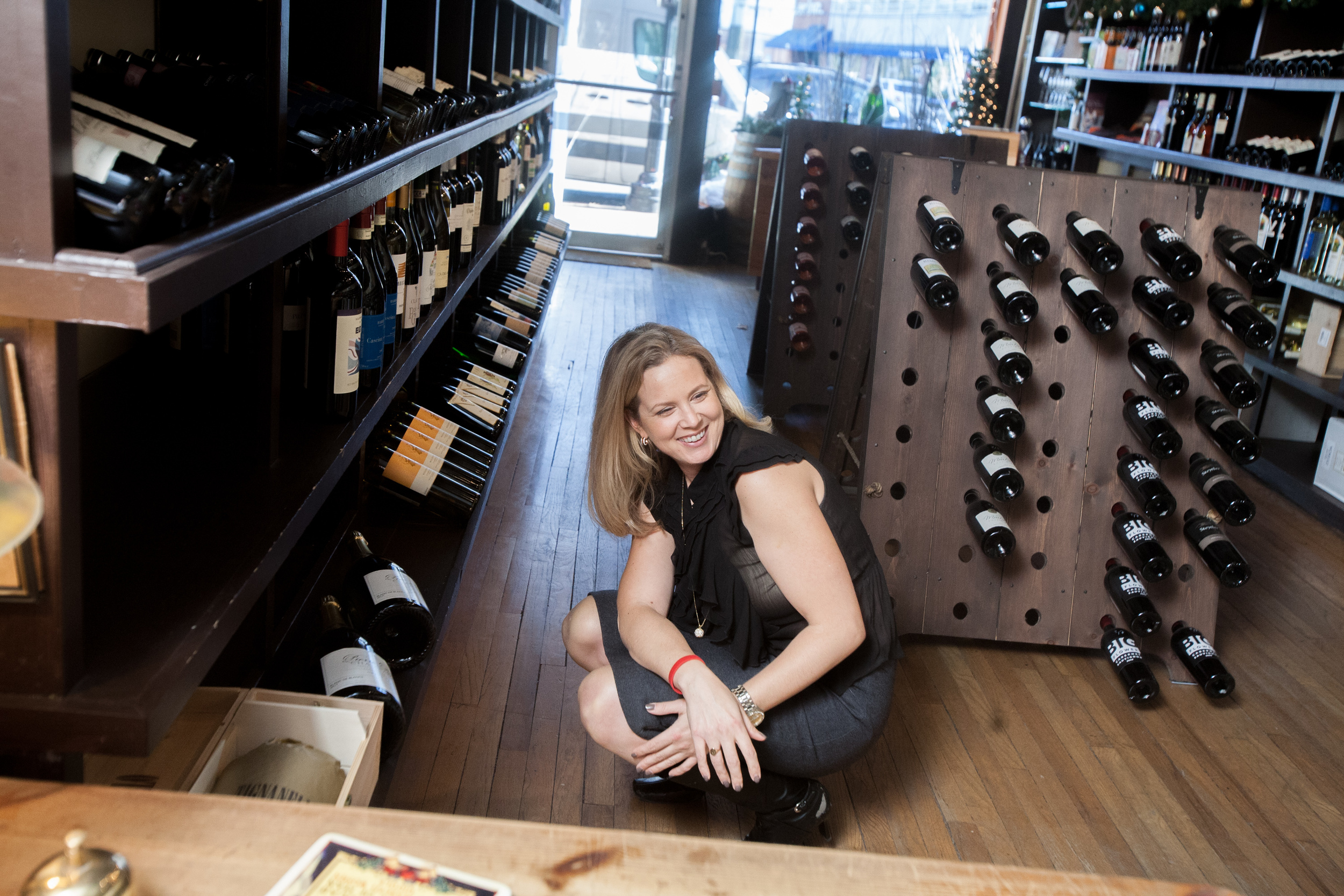 Amy has memorized where certain bottles are stored at the shop. She is planning to open a wine bar in Connecticut, but is still looking for the location. The bar will be called The Wine Lab, inspired by Elvis and her early training as a pharmacy student.