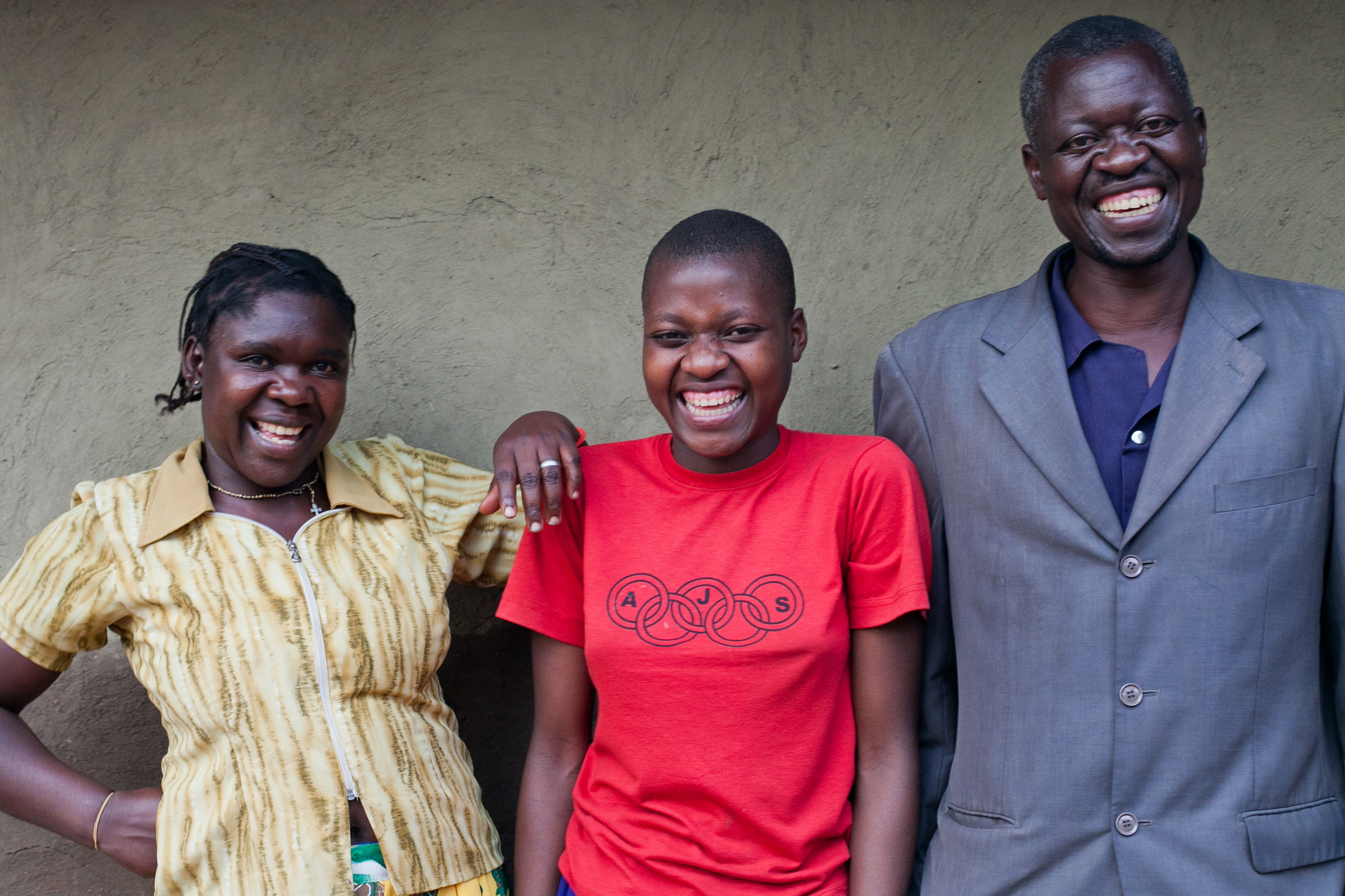 Bess, center, is in sixth grade. Here, she poses with her step-mom and dad outside their home.