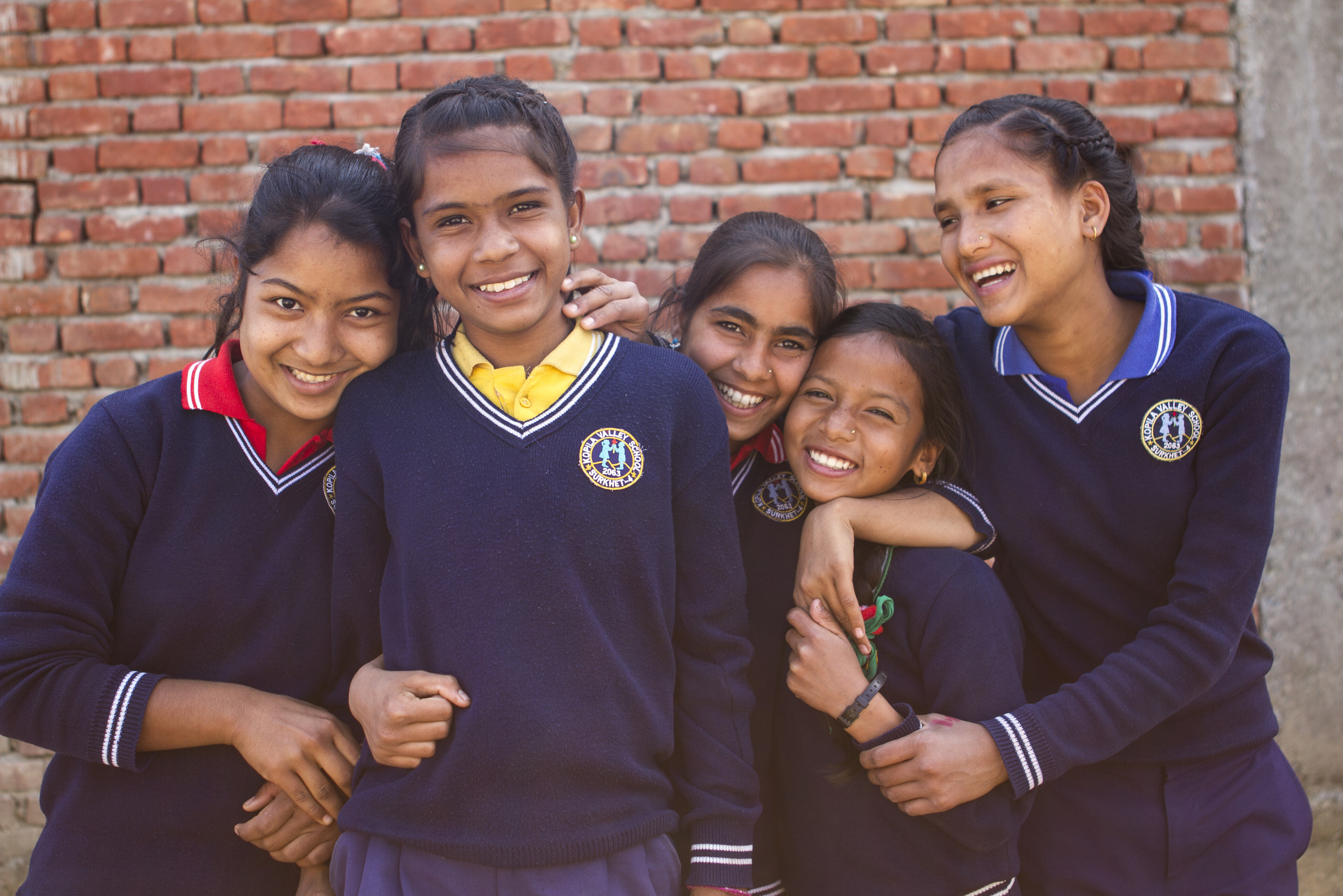 She's the First Scholars Deepa B., Durga S., Sarita A., Jharana B., and Sunita S. pose for the camera in Nepal, March 2015. (photo by Kate Lord)