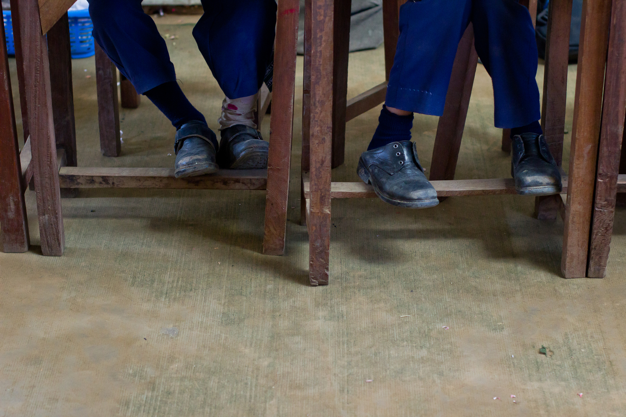 Feet of She's the First Scholar Tika G., right, in Nepal, March 2015. (photo by Kate Lord)