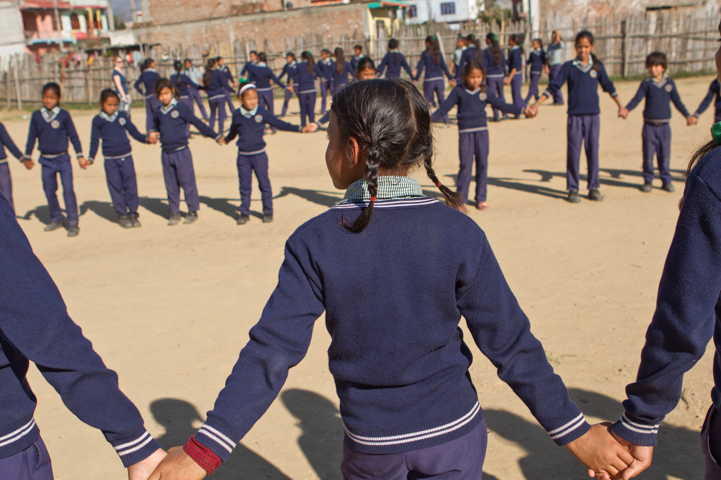 She's the First Scholar Asmita S. holds hands during a game of Red Rover in Nepal, March 2015. (photo by Kate Lord)