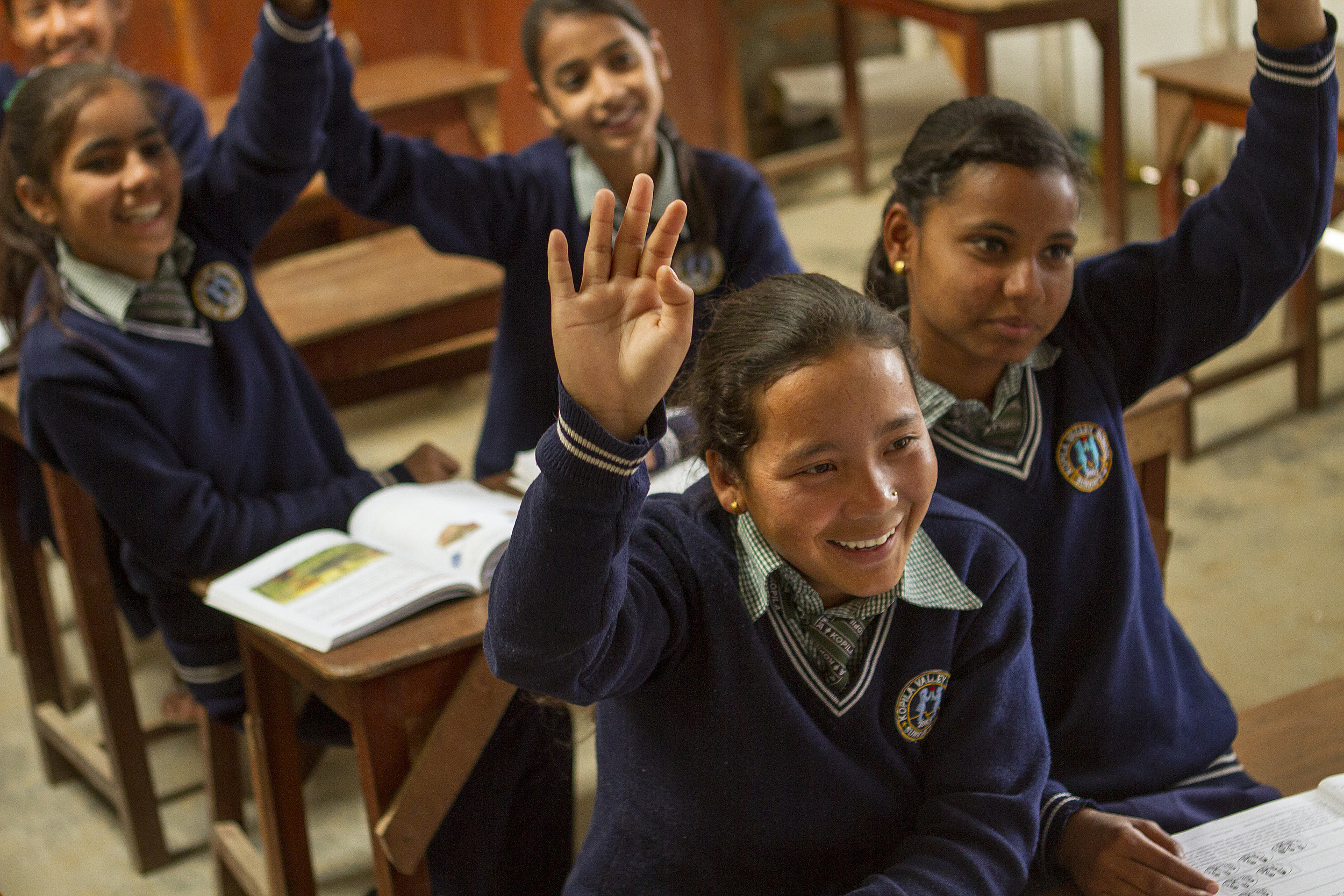 She's the First Scholar and tenth grader Roshni S. raises her hand in school in Nepal, March 2015. (photo by Kate Lord)