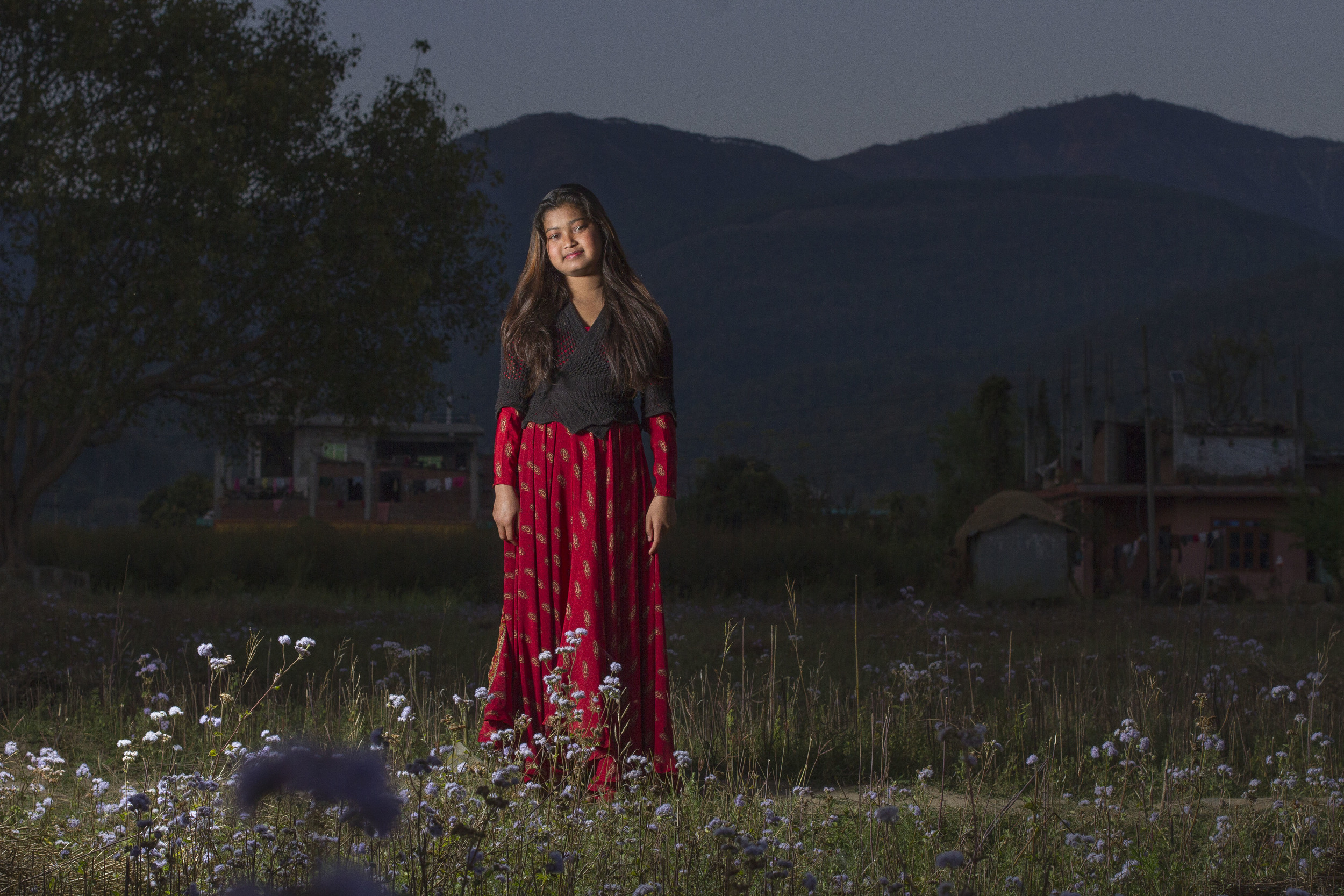 She's the First Scholar and poet Deepa N. poses in a field near her school in Nepal, March 2015. (photo by Kate Lord)