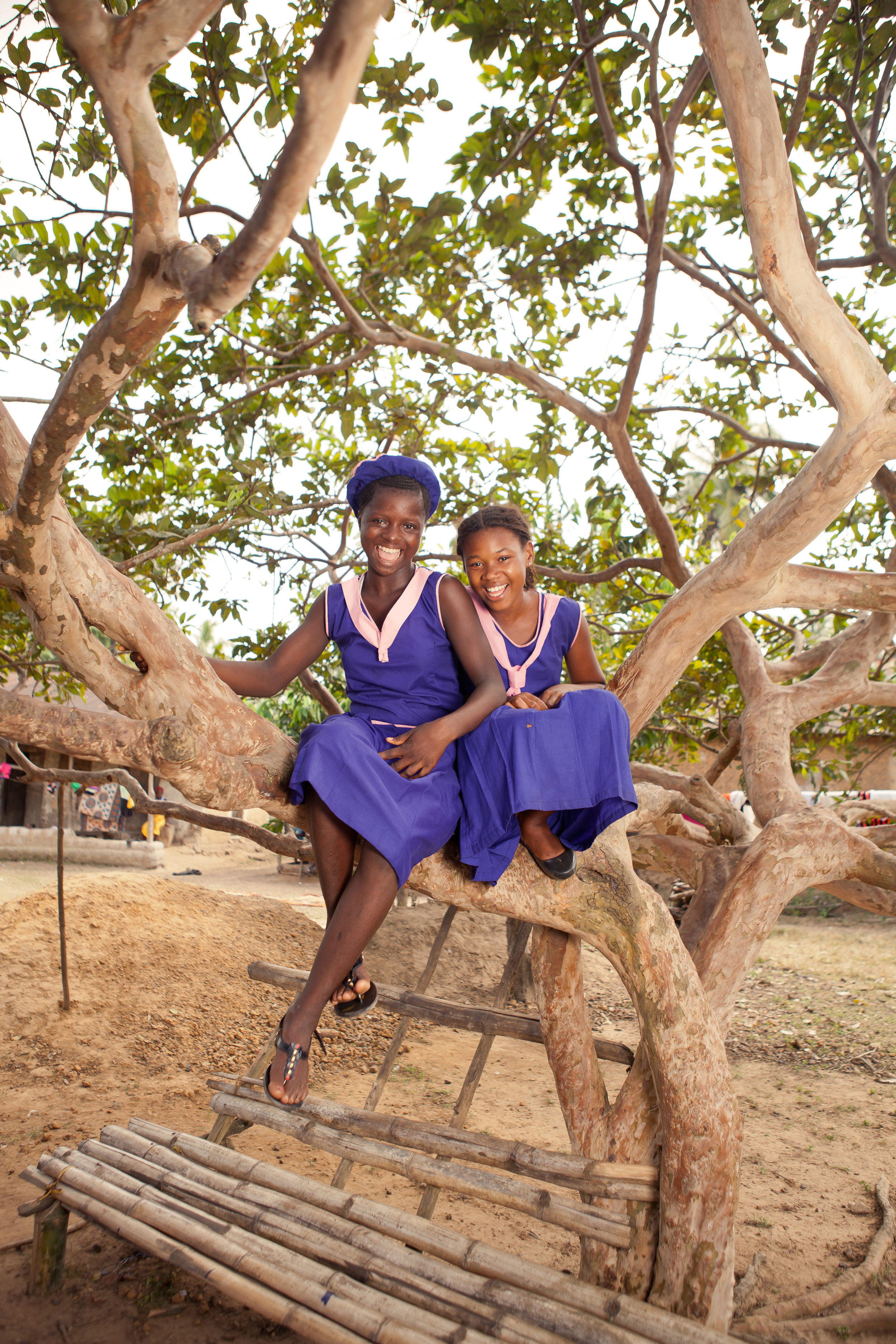She's the First Scholars Mariatu, 13, and Ramatulai, 12, in Sierra Leone, Nov. 26, 2015. Mariatu lost both of her parents and Ramatulai lost her father to the Ebola virus. Both girls are happy to be back in school after a year of closures.