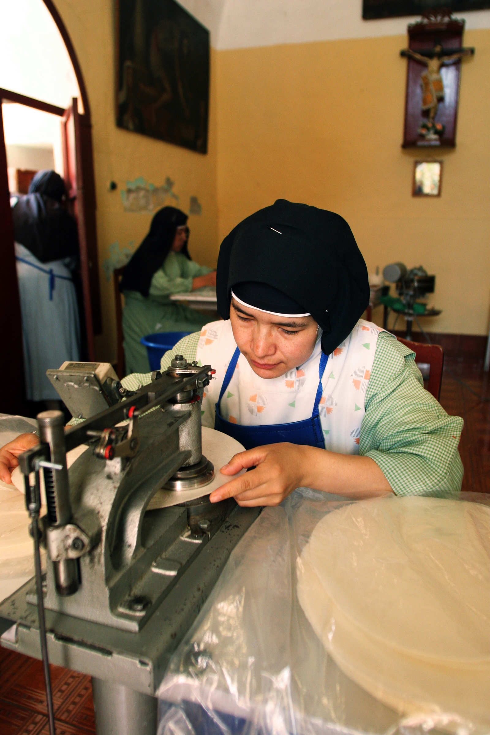 The nuns of the monastery make the unleavened bread for the local cathedral.