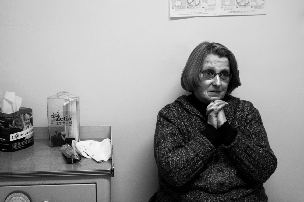 Barbara listens to Dr. Stover on her last visit to the clinic. She has qualified for Medicaid and will no longer need the clinic's services.