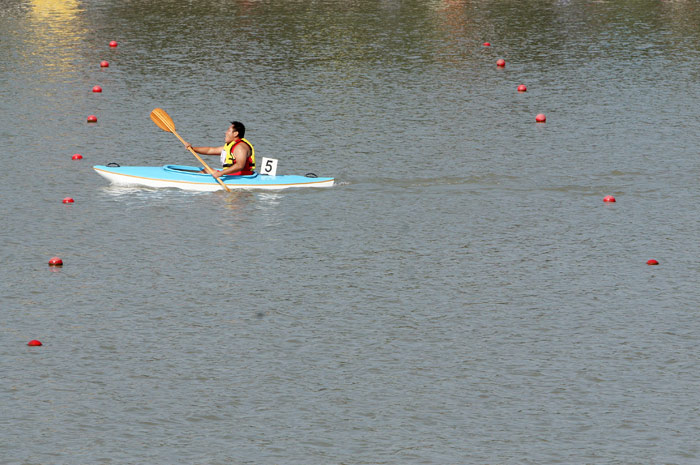 Shen Weiguo, 28, of China competes in the division seven 500 meter kayaking final at Shanghai Aquatic Sports Center.