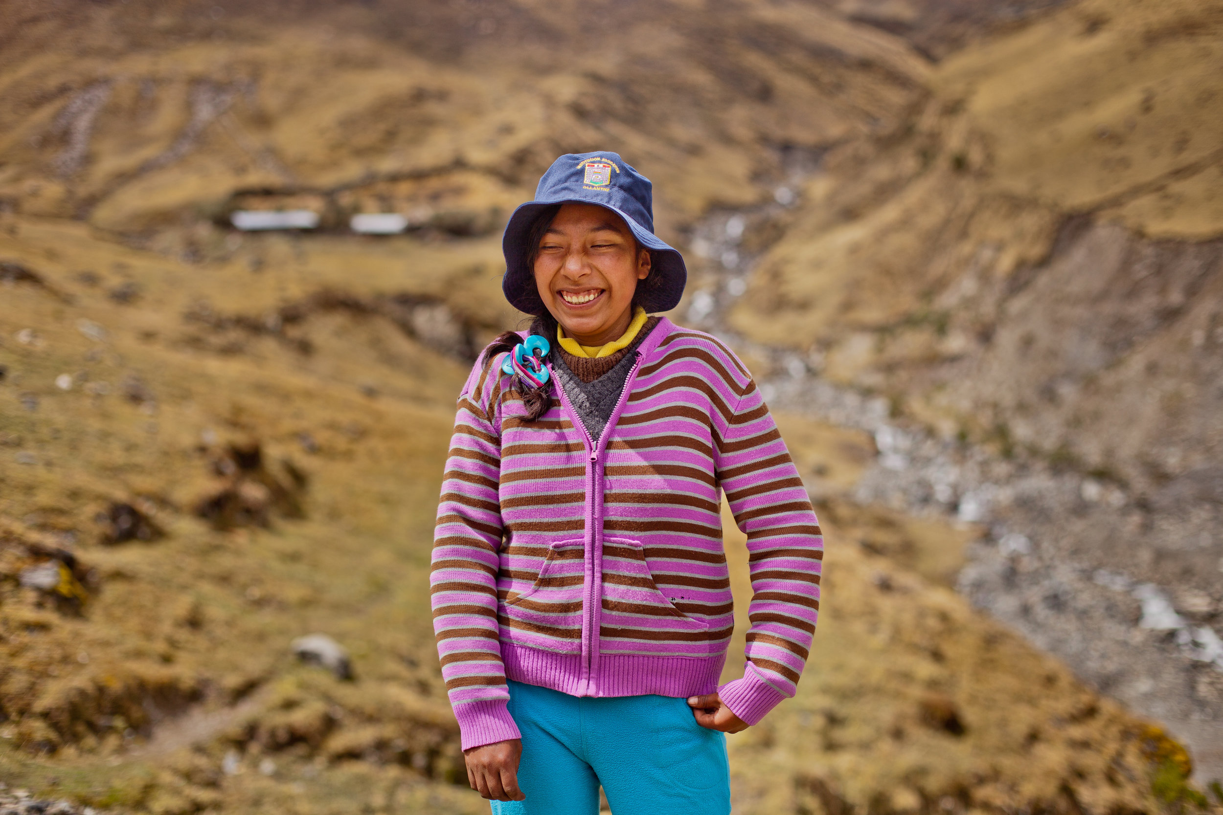 She's the First Scholar Vicentina poses near her home in Peru.