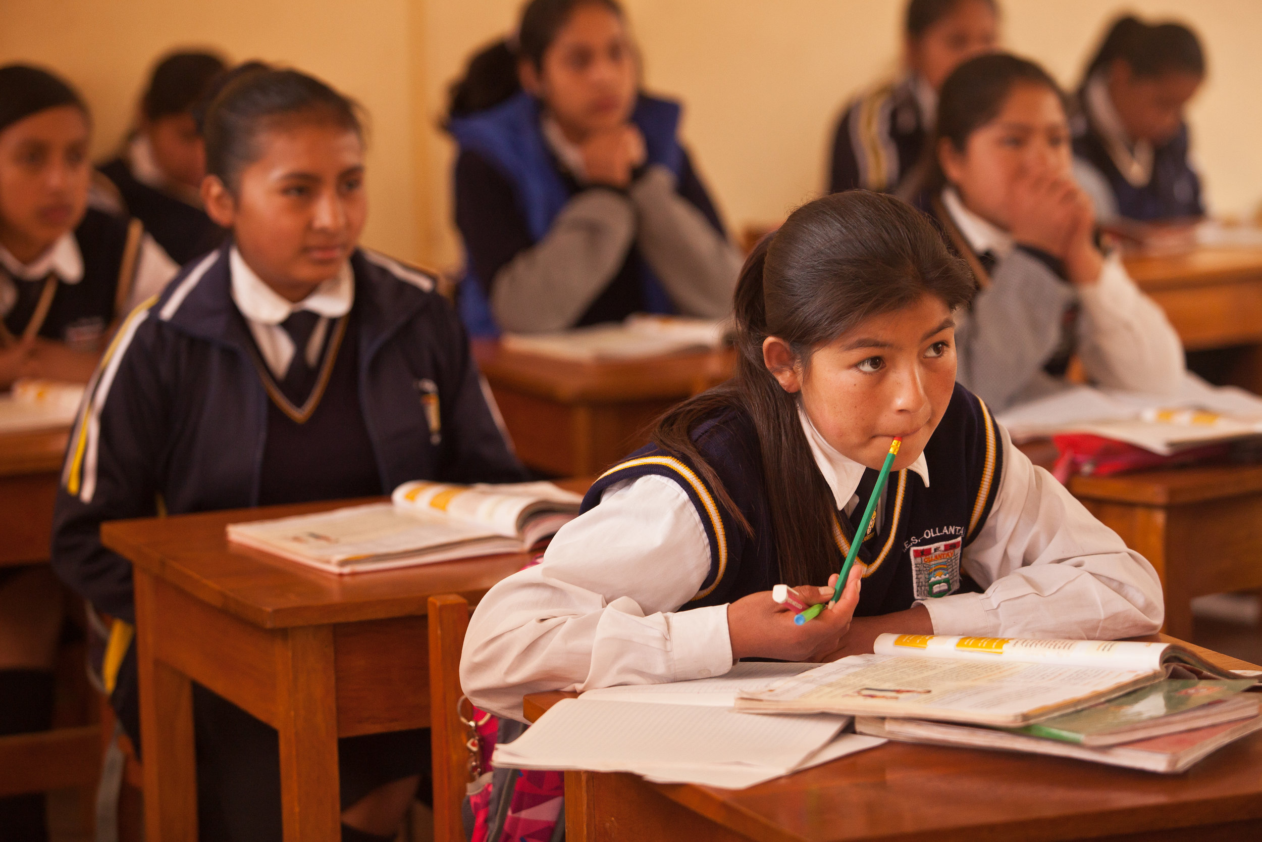 Yessenia listens in class -- she receives a scholarship from She's the First that covers both her tuition fees and all the costs involved with living with Sacred Valley Project - room & board, house mothers, mentorship, tutoring sessions and leadership skills.