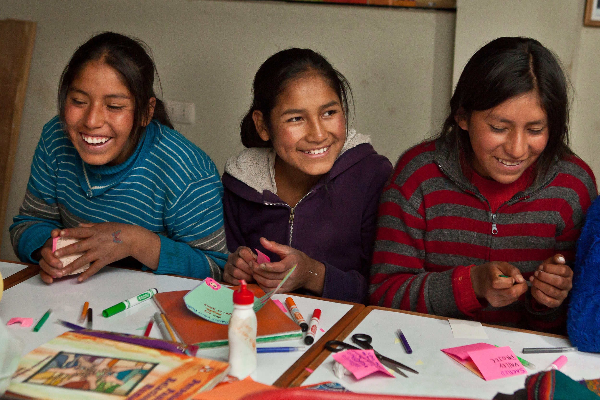 Peruvian She's the First Scholars Yakeline, Nayda, and Yaneth make cards for STF Scholars in Guatemala!