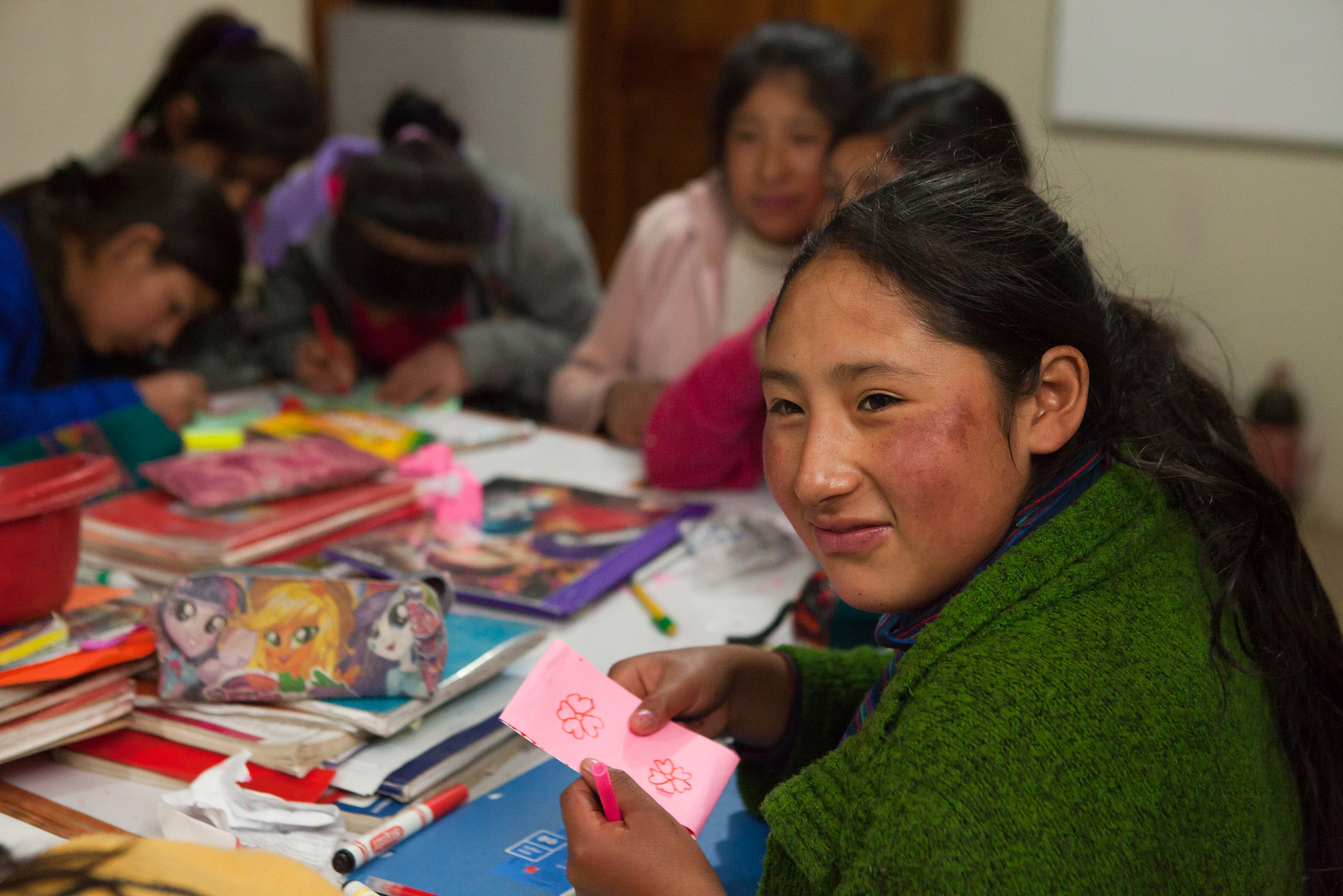 Peruvian She's the First Scholar Sinforosa makes cards for STF Scholars in Guatemala!