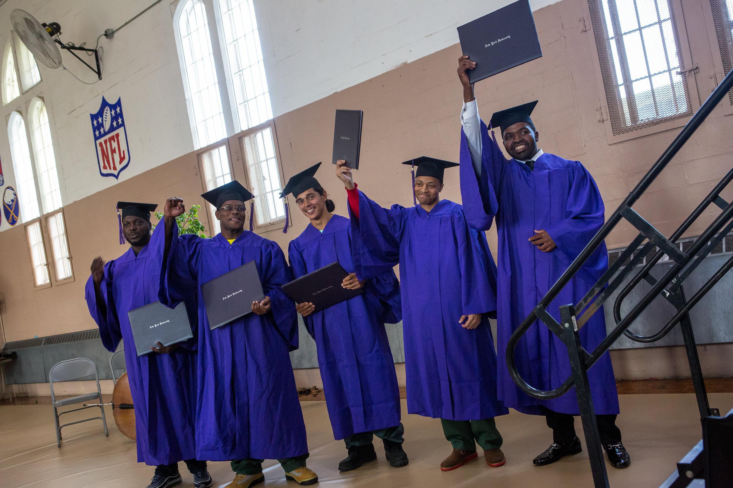 The graduates celebrate after receiving their diplomas.