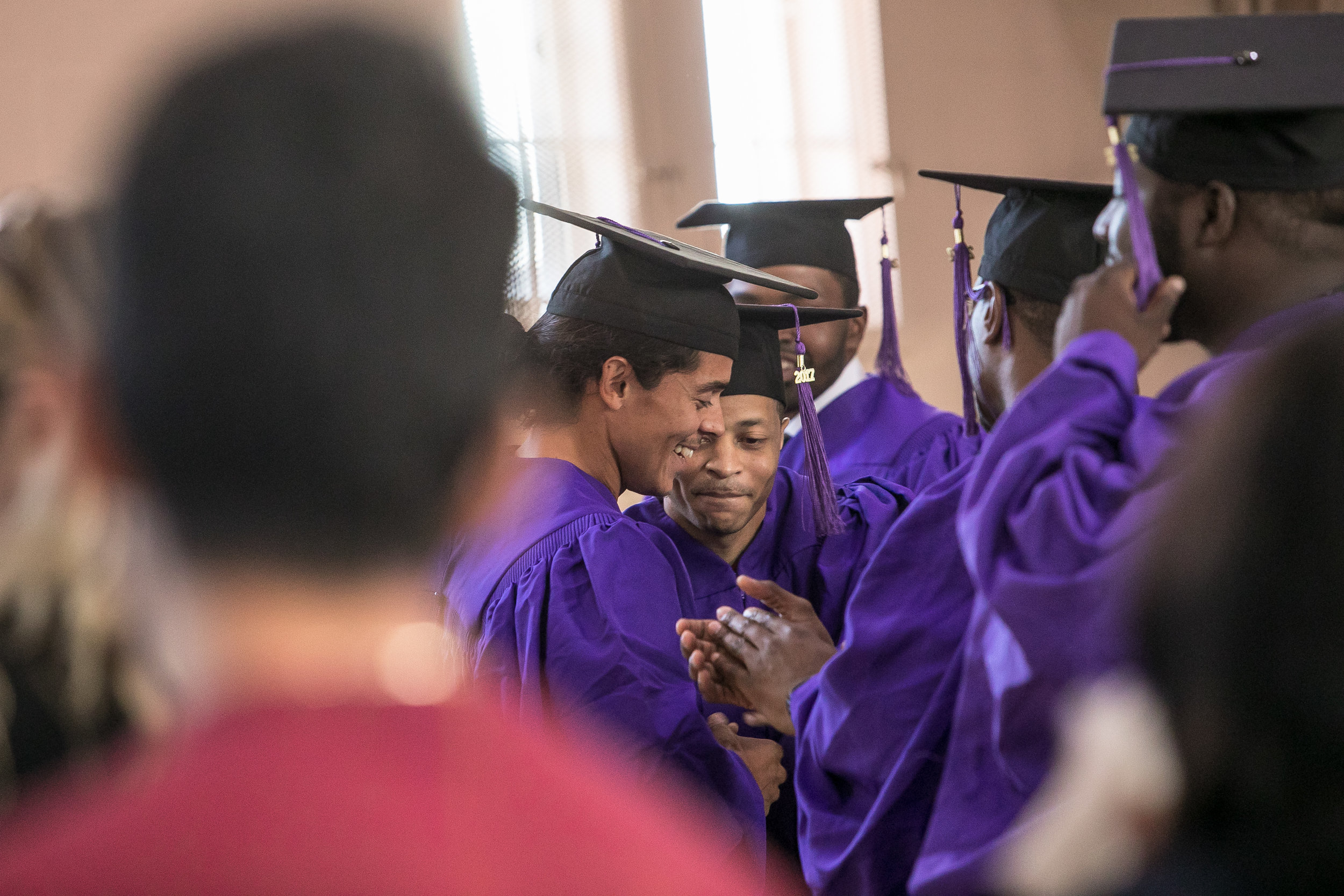 Danis Flores is congratulated by his fellow graduates after making his speech.