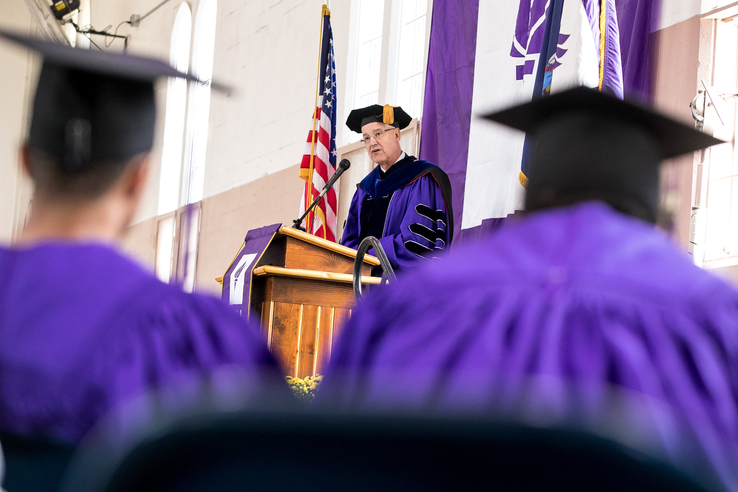 New York University President Andrew Hamilton makes his address.