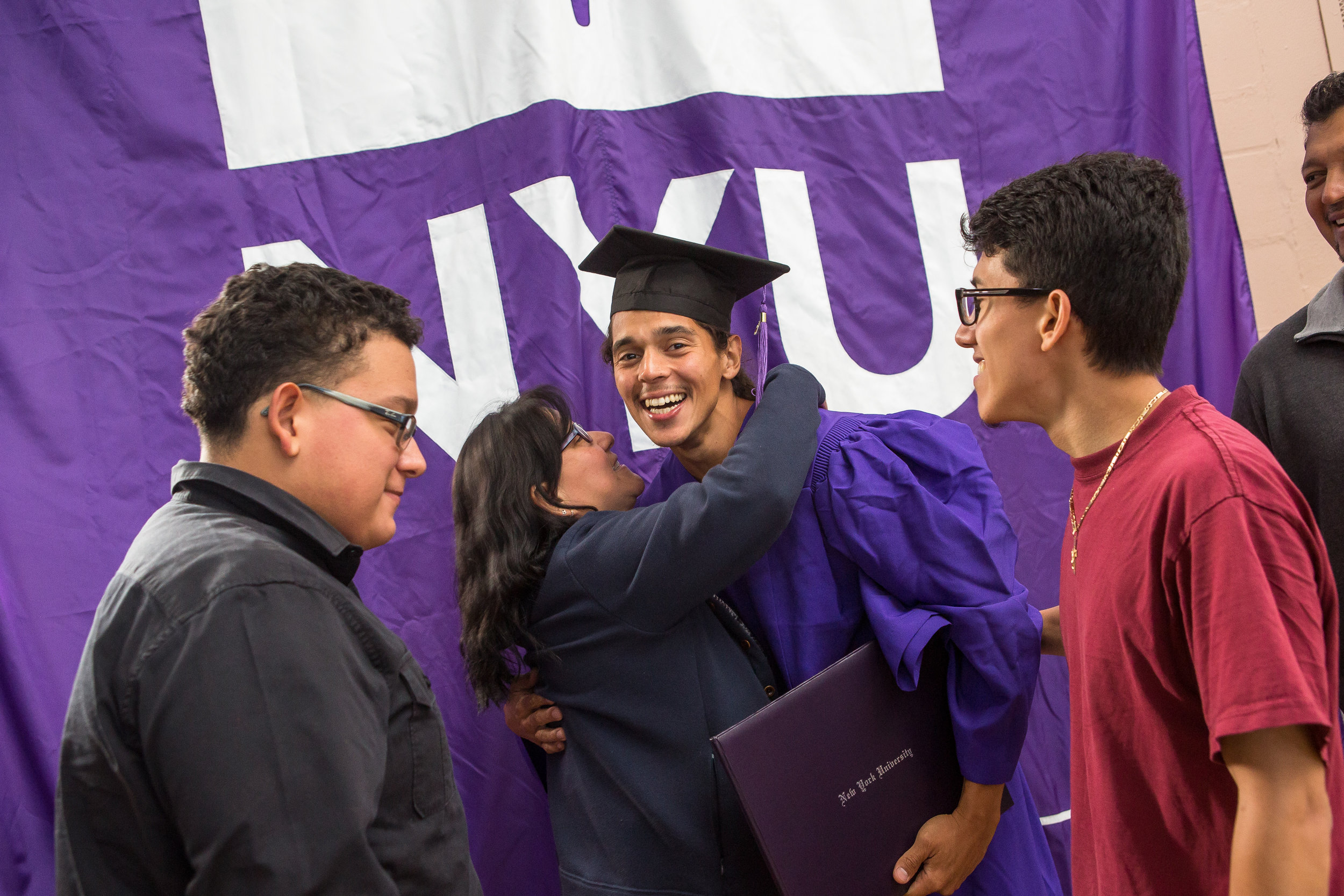 """Danis Flores is embraced by family after the ceremony.""""I've been given a second chance,"""" Danis said. """"I want to make something out of myself. I need to become somebody."""""""