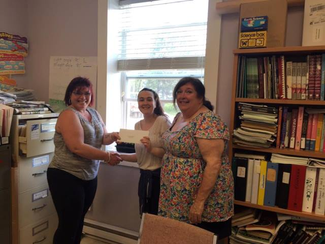 QAAW Chair Josie Lake (left) presents a Letter of Invite to The Hants Learning Centre