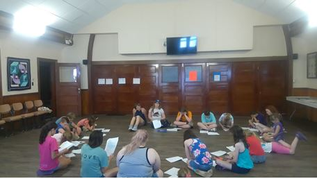 Camp leader Morgandy guiding campers through a read through of the script.  Photo credit: Ally Loiselle