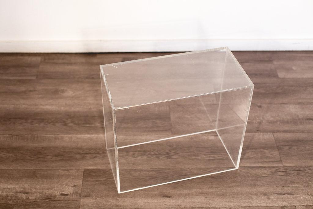 "Acrylic Side Table 19.5"" L 9.5"" W 17""W Quantity: 1 Price: $35"