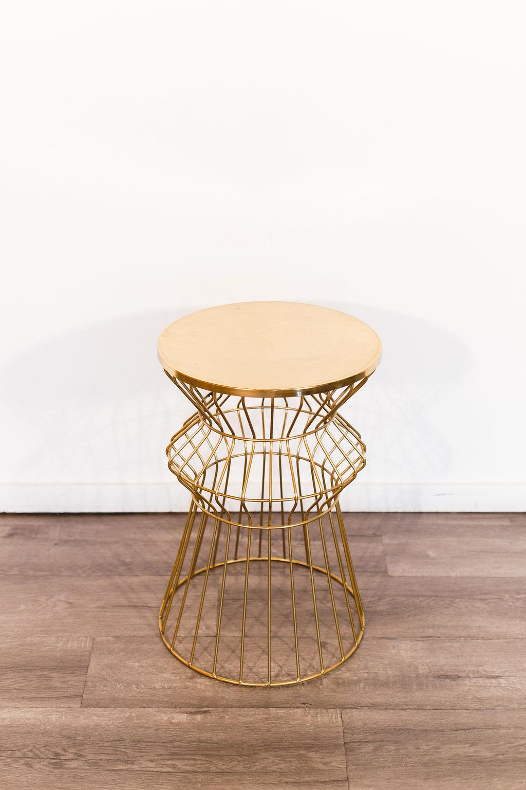 "Gold Table 15"" diameter 22.5"" tall Quantity: 1 Price: $50"