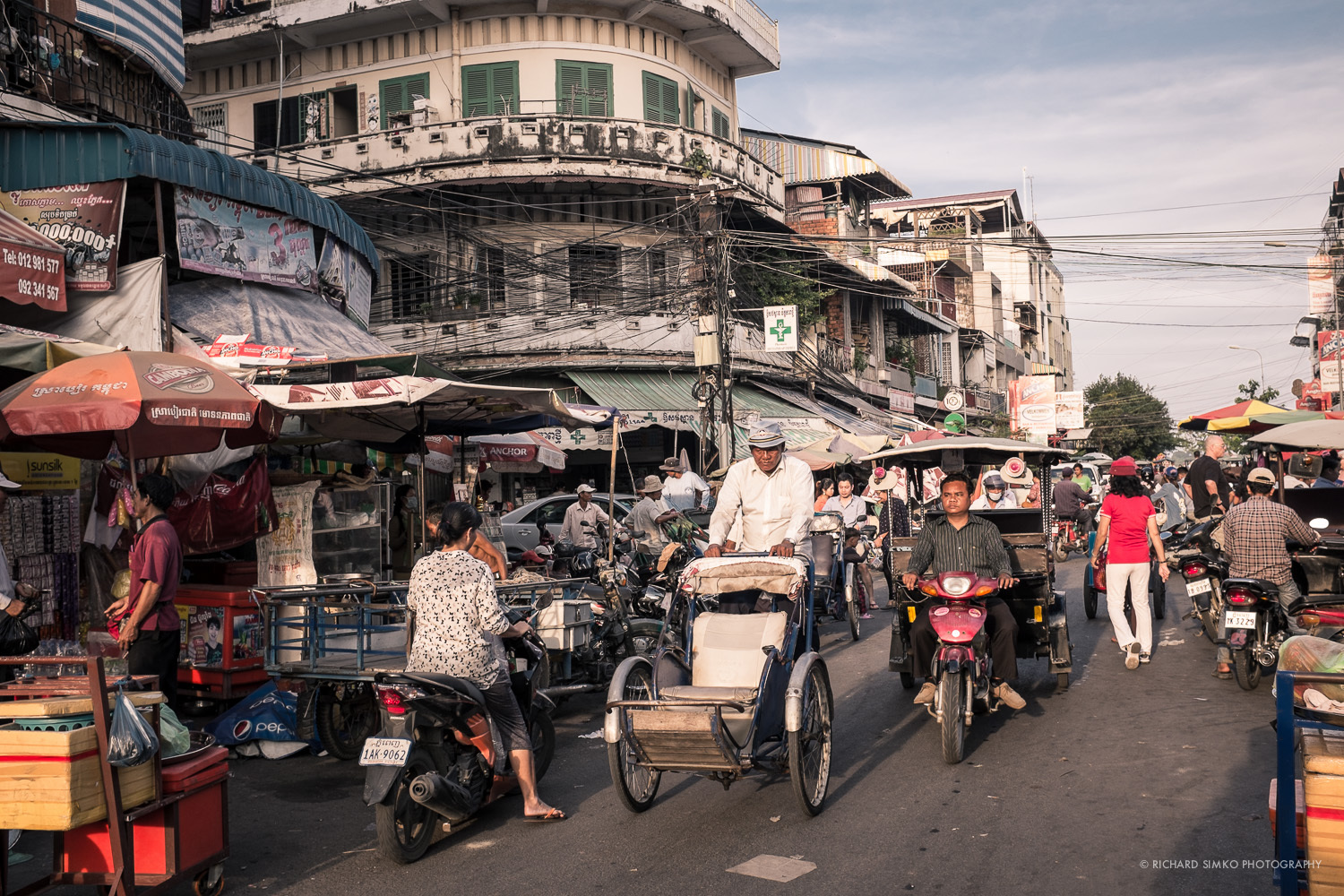 Bustling streets of Phnom Penh in late afternoon.